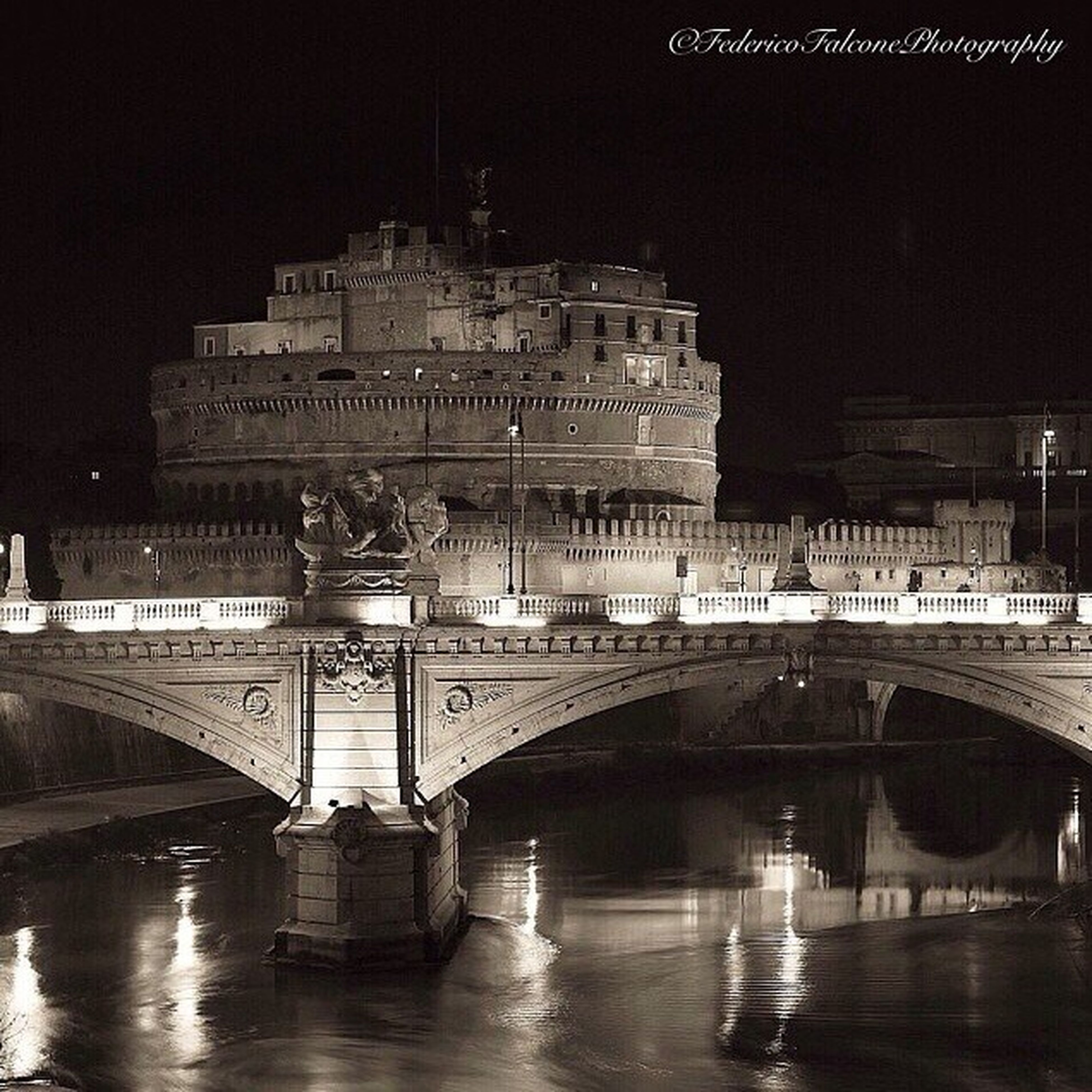 architecture, built structure, connection, bridge - man made structure, transportation, illuminated, night, arch, river, engineering, water, travel destinations, famous place, bridge, arch bridge, city, travel, building exterior, reflection, waterfront