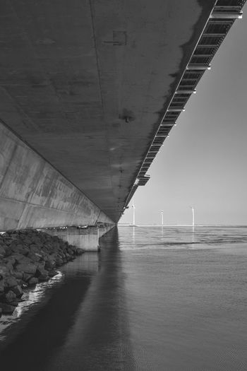 Architecture Bridge - Man Made Structure Built Structure Connection Day Horizon Over Water Nature No People Outdoors Road Sea Sky Transportation Underneath Water Wind Power Wind Turbine