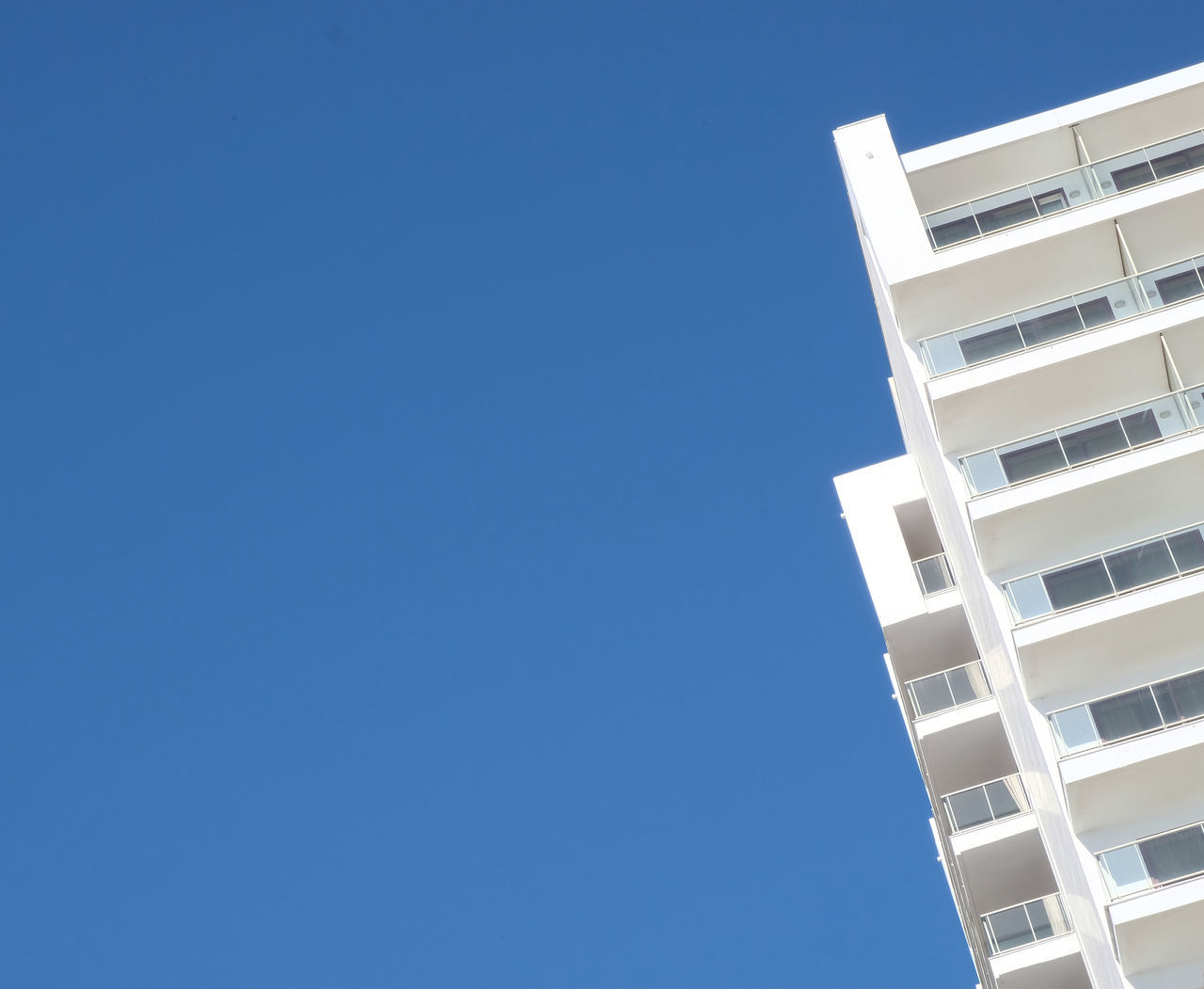 Architecture Balconies Blue Clear Sky Copy Space Day Deserted Emptiness High Contrast High Resolution Low Angle View Minimalistic No People Outdoors Sky Skyscraper Slanted SPAIN Sunny Day Torremolinos. Málaga. Tranquility Tranquility Scene Travel Destinations White And Blue White Building