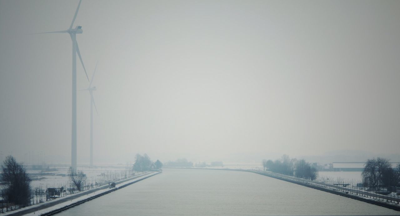 Winter Cold Temperature Snow Transportation No People Driving Soul Searching Capture The Moment Eye4photography  Soulseeker Lightseeker Ontheroad Drivebyphotography Mistymorning Fog Mist Tree Water Hazy  The Way Forward Dutch Landscape Dutch Countyside