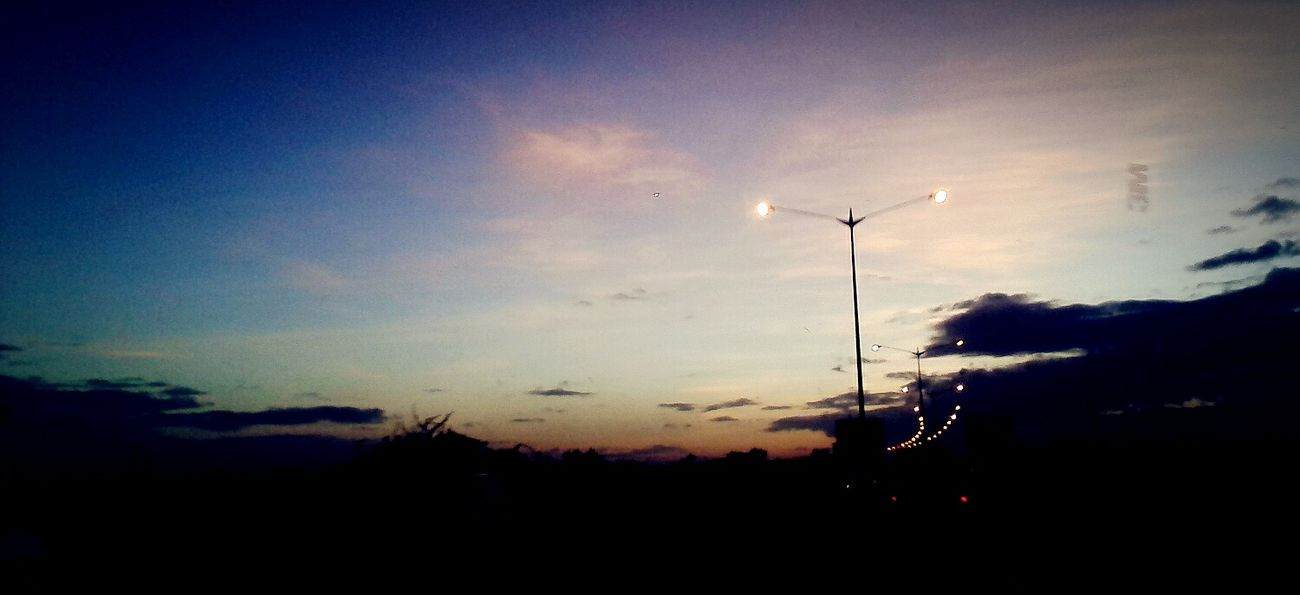 FrontSeatShot Gettingdark Streetlights Highway Cellphoneshot meow meoooow. Good morning eyeem
