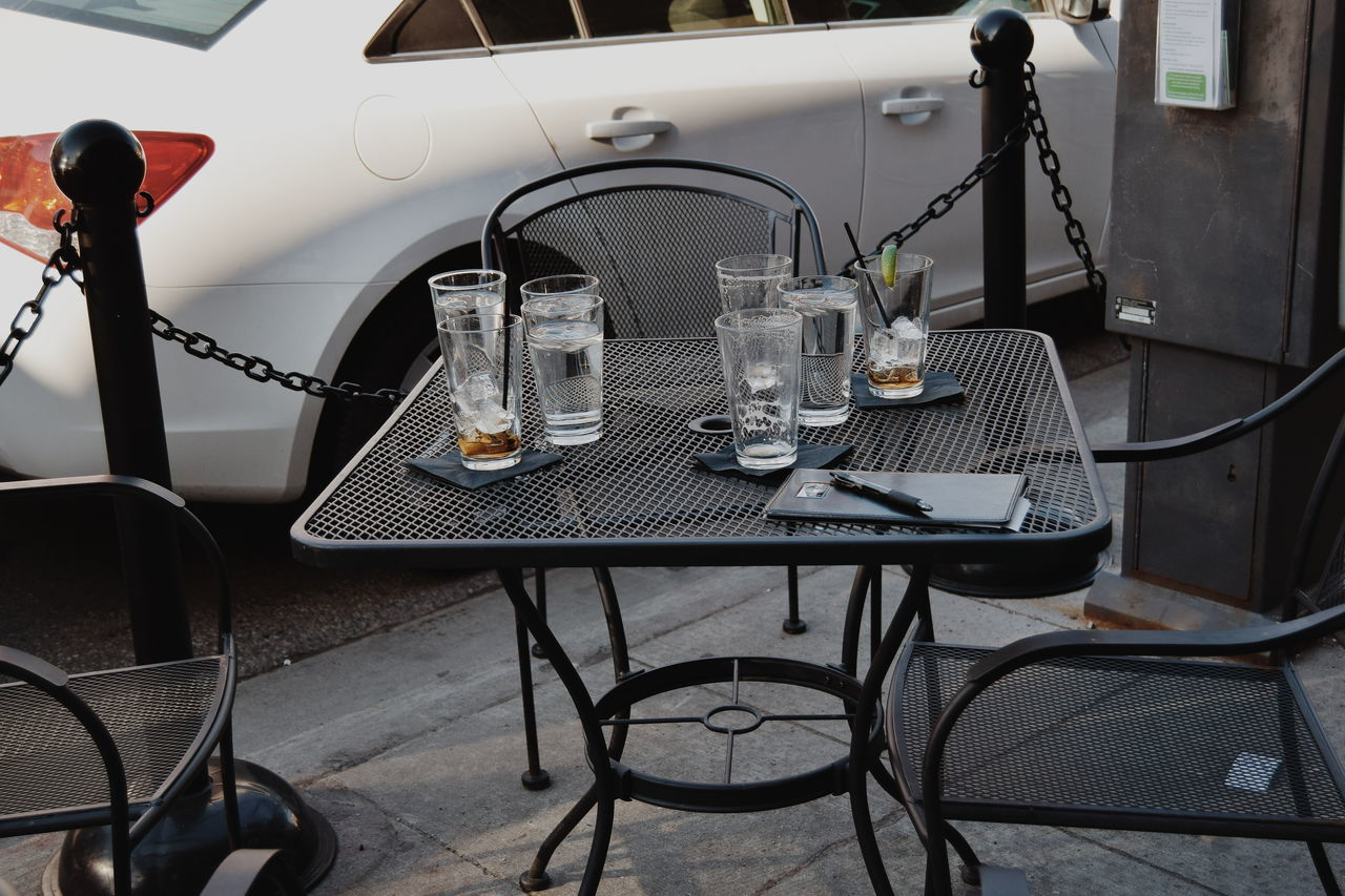 Tourist Downtown Ann Arbor Ann Arbor Michigan Traveling Urban VSCO Modern Traffic Empty Cups Empty Glasses Empty Glass Empty Cups Empty Chairs Empty Table Water Outside Outside Dining Drink Up Up Close Street Photography The Street Photographer - 2016 EyeEm Awards The Essence Of Summer