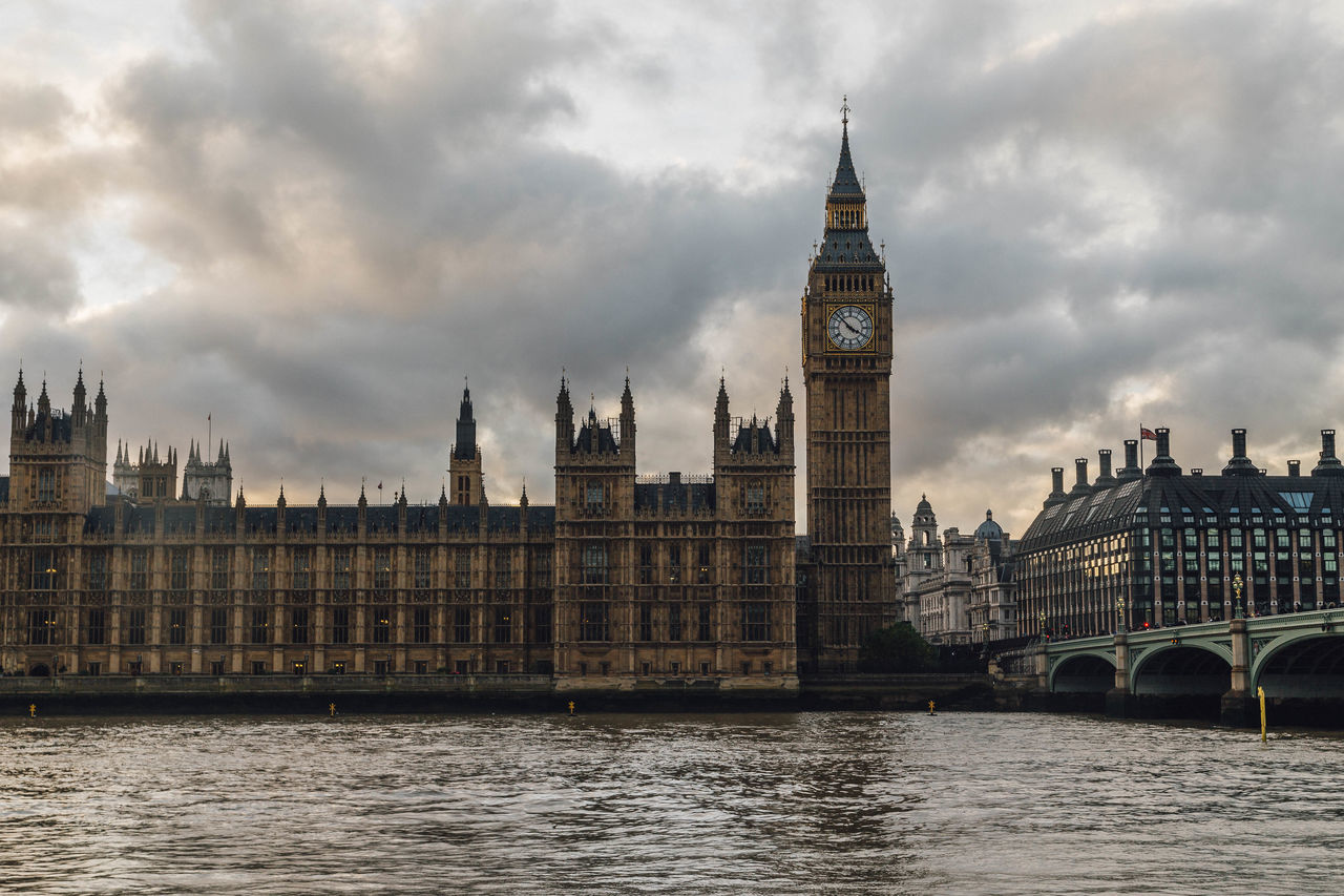 architecture, cloud - sky, built structure, clock tower, sky, building exterior, river, travel destinations, water, government, waterfront, day, no people, bridge - man made structure, city, outdoors, politics and government