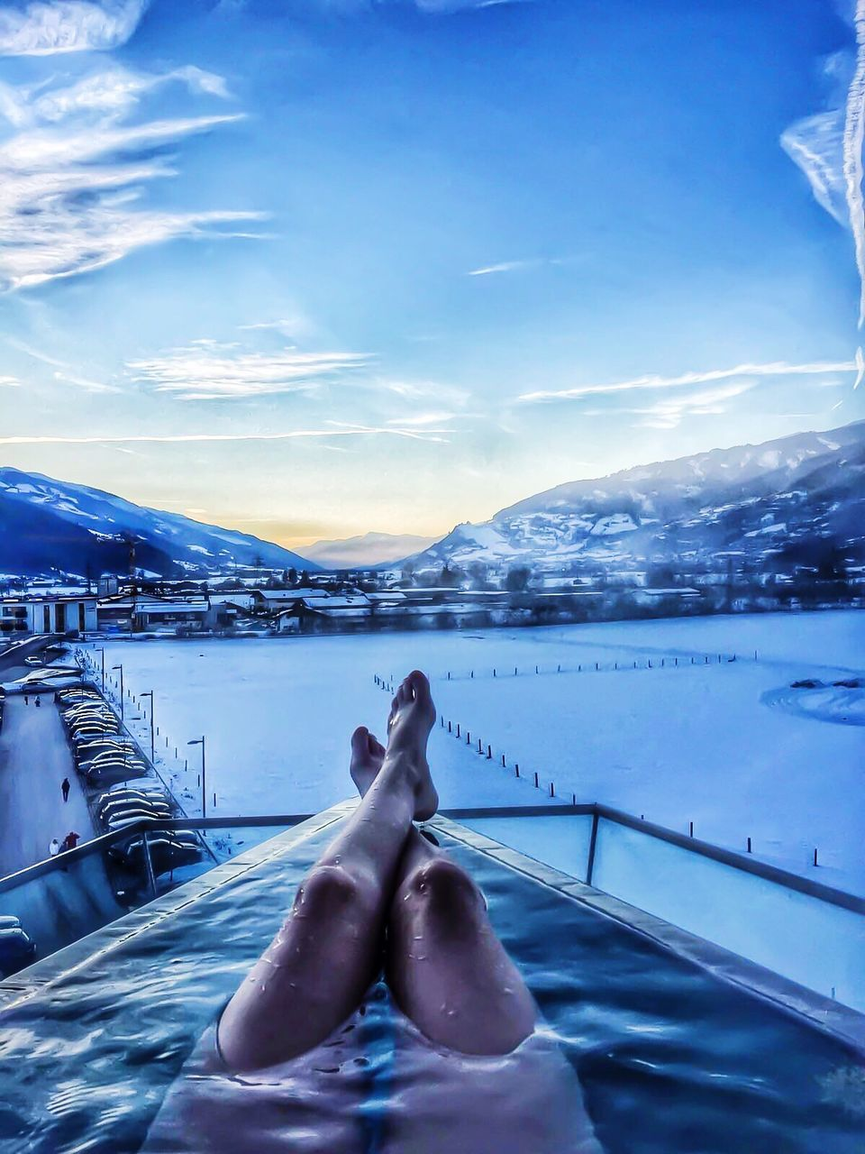 human leg, water, cloud - sky, low section, sky, one person, outdoors, mountain, real people, human body part, beauty in nature, swimming pool, day, nature, relaxation, lifestyles, scenics, women, nautical vessel, people