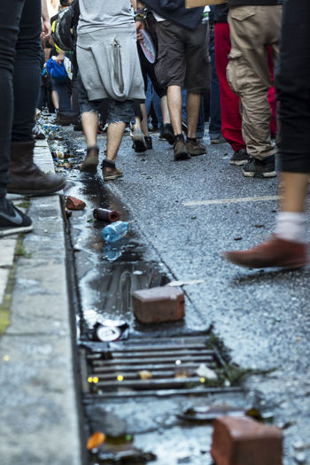 G20 Demonstration 2017 G20 Gipfel G20 Summit NOG20 Reflection Trash Ax Axvo Bottle Bottles Bricks Crowd Day Demonstration Demonstrations  Feet Large Group Of People People People And Places Shoes Street Streetphotography Water