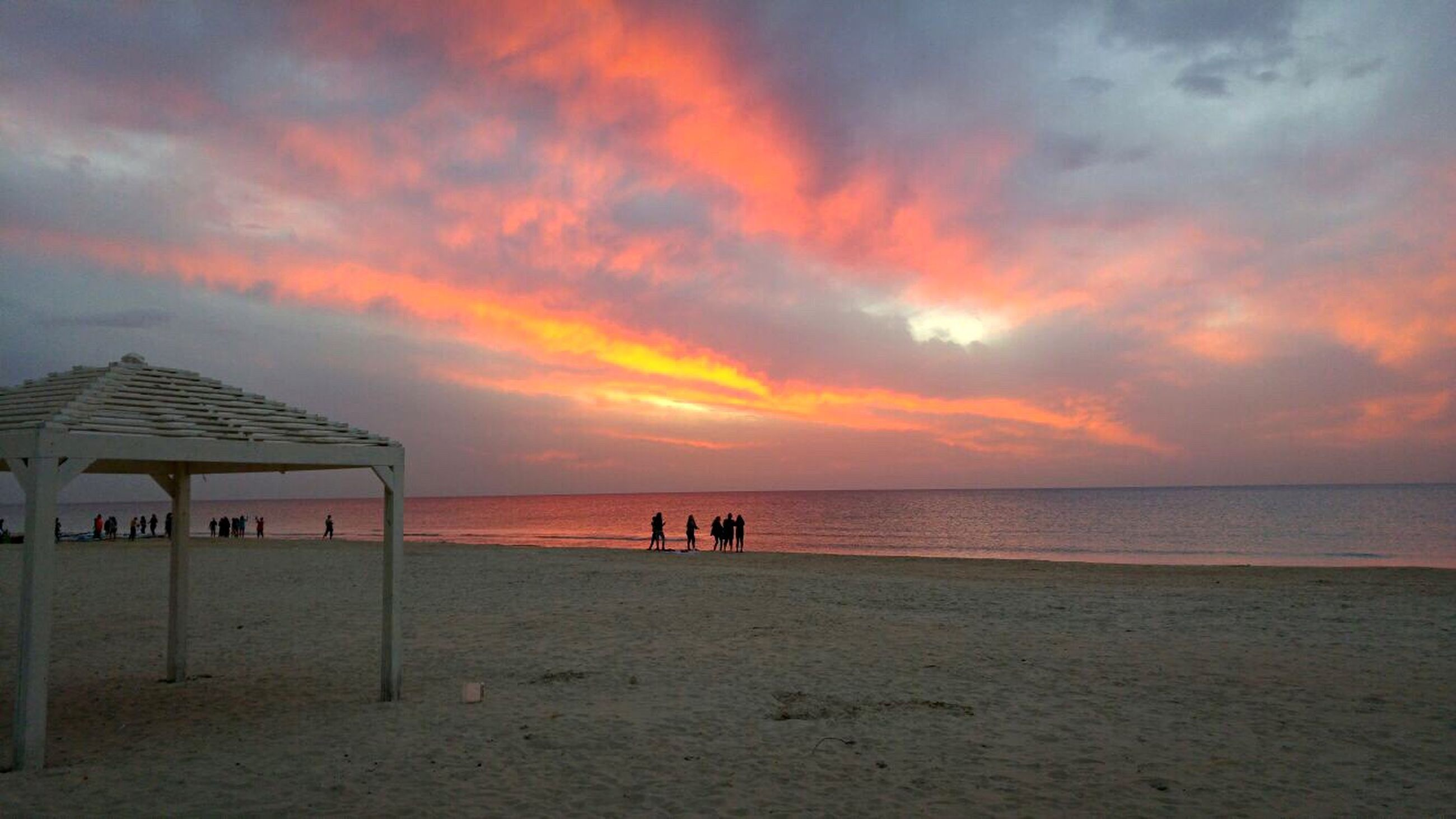 sea, horizon over water, beach, water, sunset, sky, scenics, beauty in nature, shore, tranquil scene, tranquility, cloud - sky, orange color, sand, idyllic, nature, vacations, incidental people, cloud, outdoors
