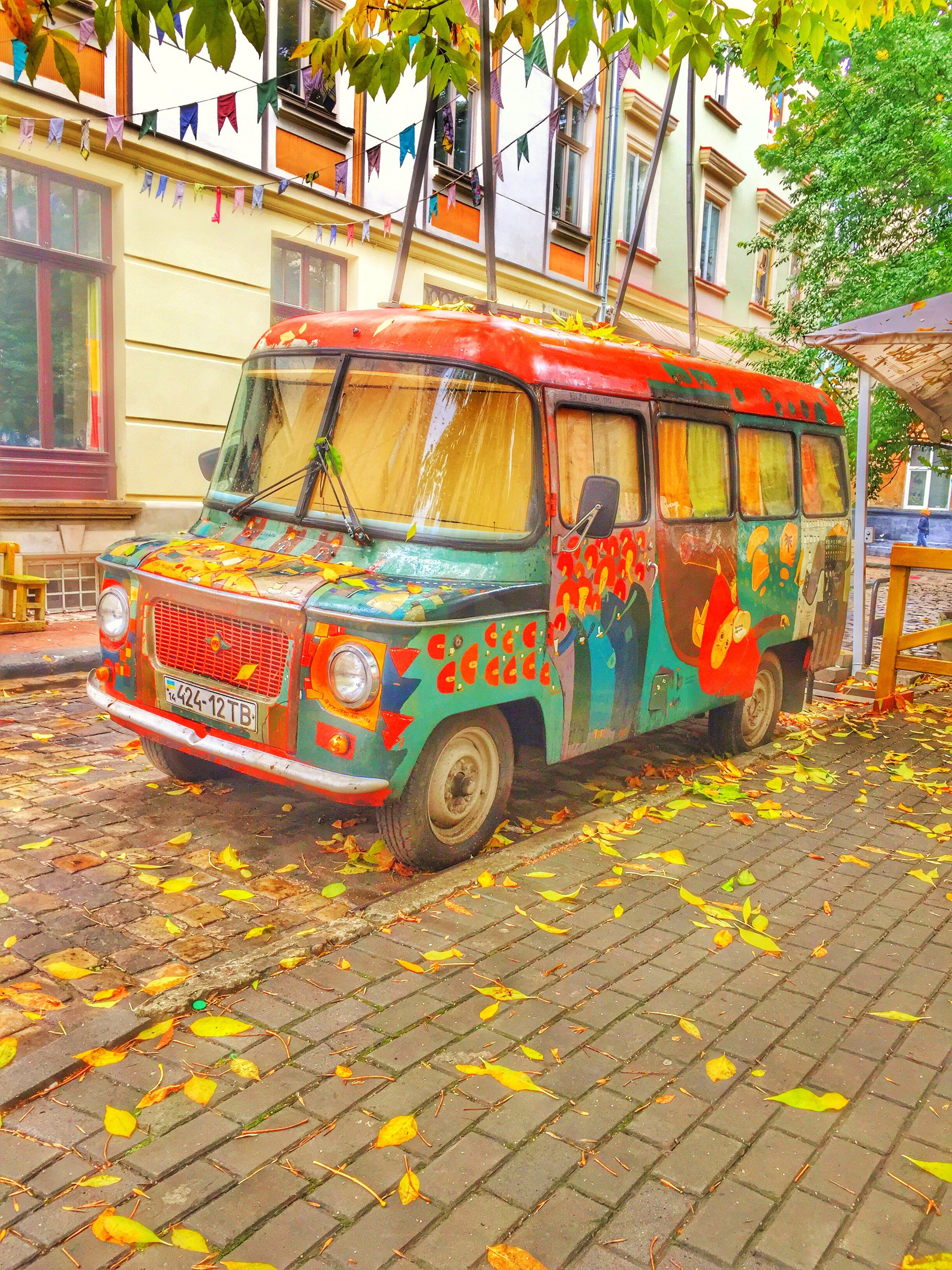 transportation, architecture, built structure, mode of transport, building exterior, day, multi colored, outdoors, abundance, paving stone, creativity, facade, retail