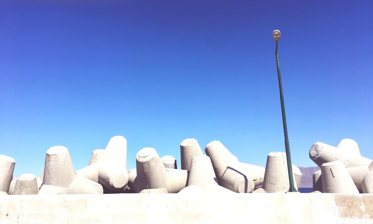 low angle view, day, clear sky, outdoors, no people, blue, sculpture, sky