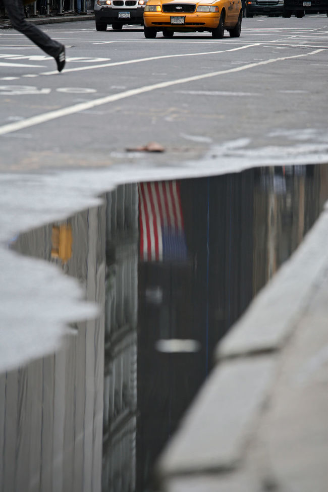 UPhold the flag American Flag City City Life City Street Day Diminishing Perspective Empty Focus On Foreground No People Nyc Street Life NYC Street Sce Outdoors Parking Lot Road Selective Focus Stationary Surface Level The Way Forward Vanishing Point Water