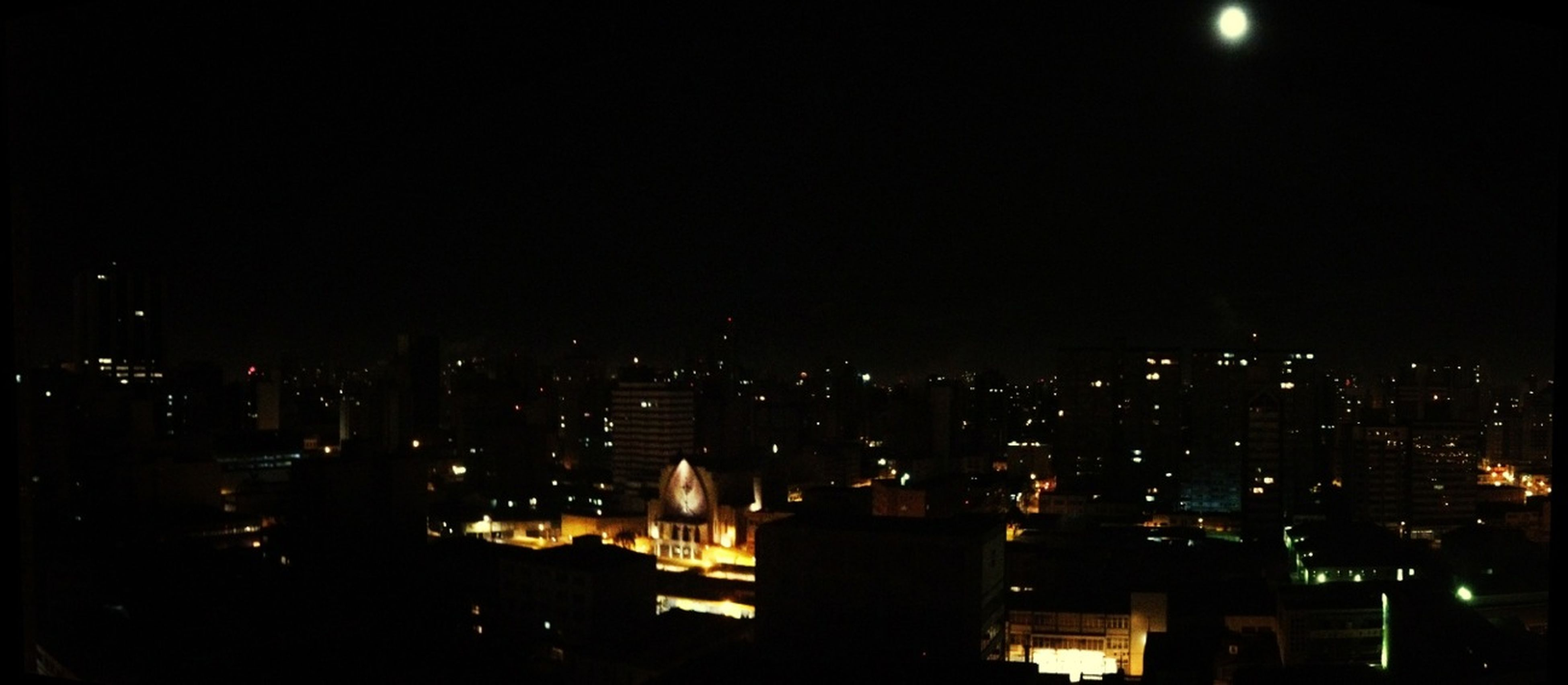 night, illuminated, city, cityscape, architecture, building exterior, built structure, dark, crowded, skyscraper, modern, copy space, sky, clear sky, high angle view, city life, residential building, no people, residential district, light - natural phenomenon