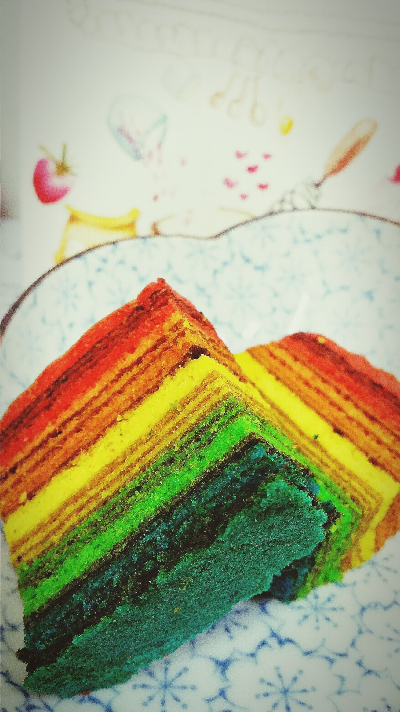 Trying to come to terms with this Rainbow coloured Kuih Lapis (usually brown. Diagonally they resemble mille crepe cakes save that there is no cream in kuih lapis) given by a colleague's client... and failing Cakes Chinesenewyeariscoming Chinese New Year Multiple Layers Multi Colours Food Confectionery Foodcollection Foodphotography EyeEm Gallery Eyeem CNY Eyeem Collection Eyeem Photography