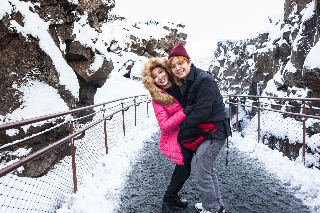 Thingvellir National Park or better known as Iceland pingvellir National Park during winter Beauty In Nature Cold Temperature Day Full Length Happiness Jacket Leisure Activity Love Nature Outdoors Smiling Snow Thingvellir Thingvellir National Park Thingvellir National Park Iceland Togetherness Two People Warm Clothing Weather Winter Young Adult þingvellir Þingvellir National Park Þingvellir National Park Iceland Snow Winter Þingvellir National Park, Iceland