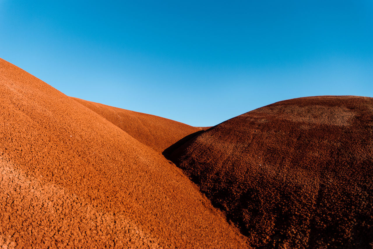 Painted Hills, Oregon Red blue sky sand dune Desert Clear sky landscape archival arid climate sand Nature day no people outdoors beauty in Nature sky miles away EyeEmNewHere