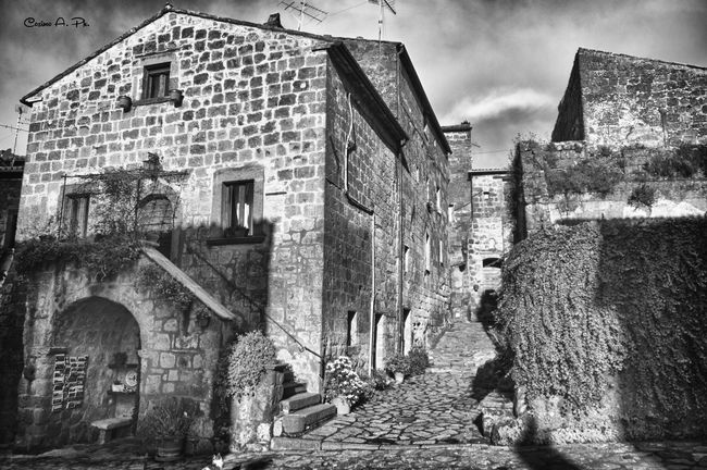 Civita Di Bagnoregio Building Exterior Architecture Built Structure Outdoors Day City Real People Person Horizontal People Sky One Person Adult Close-up EyeEm Gallery Populer Photos Popular Photo Popular Popular Photos Black And White Photography Blackandwhite Black & White Black And White Blackandwhite Photography