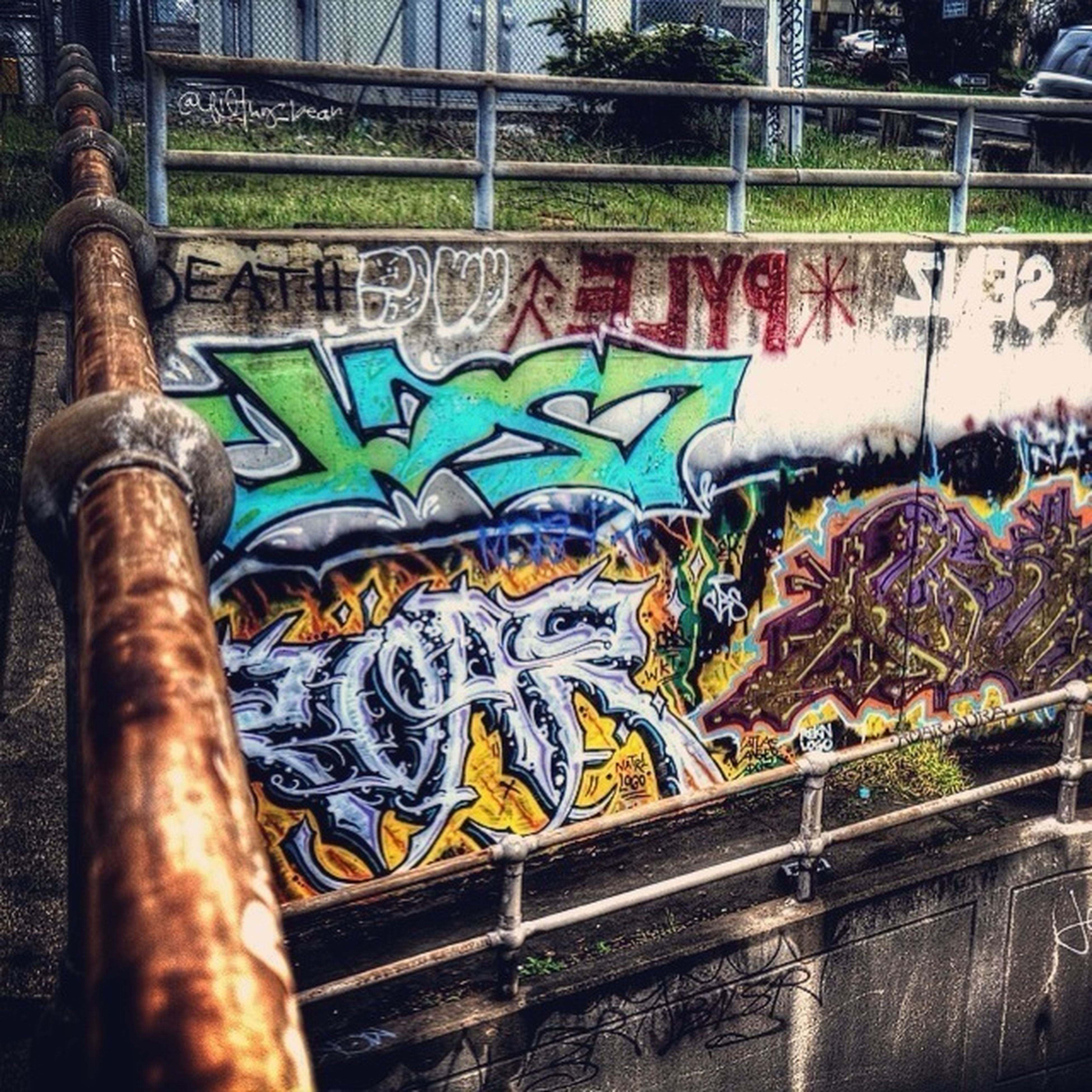 graffiti, art, creativity, art and craft, multi colored, built structure, architecture, wall - building feature, building exterior, tree, day, street art, outdoors, design, no people, railing, pattern, wall, human representation, mural