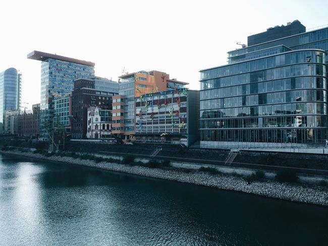 Architecture Building Exterior Built Structure City Water Waterfront Riverbank City Life Day Outdoors Office Building Development No People Building Story Tall Düsseldorfer Hafen Rhein Hafen People And Places. Clear Sky City Riverside Düsseldorf Am Rhein Architecture Düsseldorf
