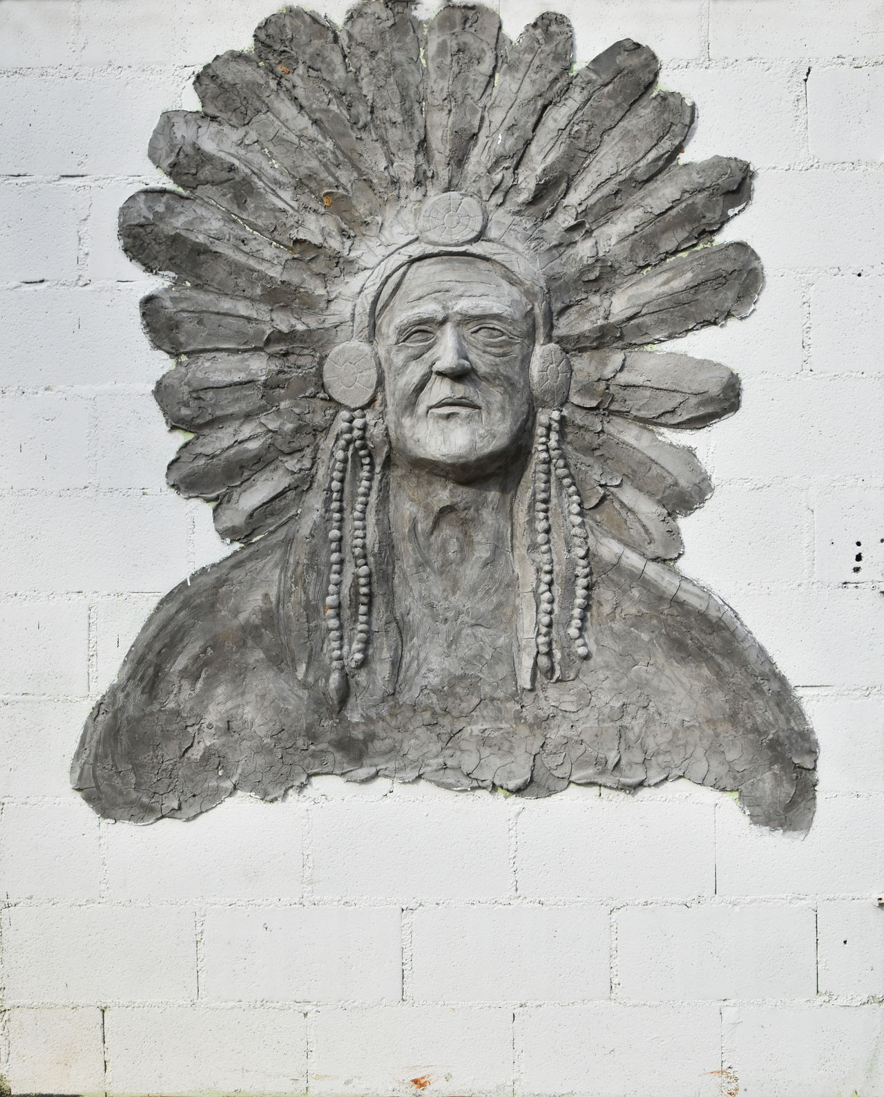 Why this American Indian chief bas relief has appeared at toilet of Koh Samui island in Thailand? For me it is still a question. American American Indian Art Artistic Authentic Bas Relief Basrelief Cement Chief Concrete Ethnic Feather  Feathers Indian Native Native American Indian Old Original Q Relief Stone