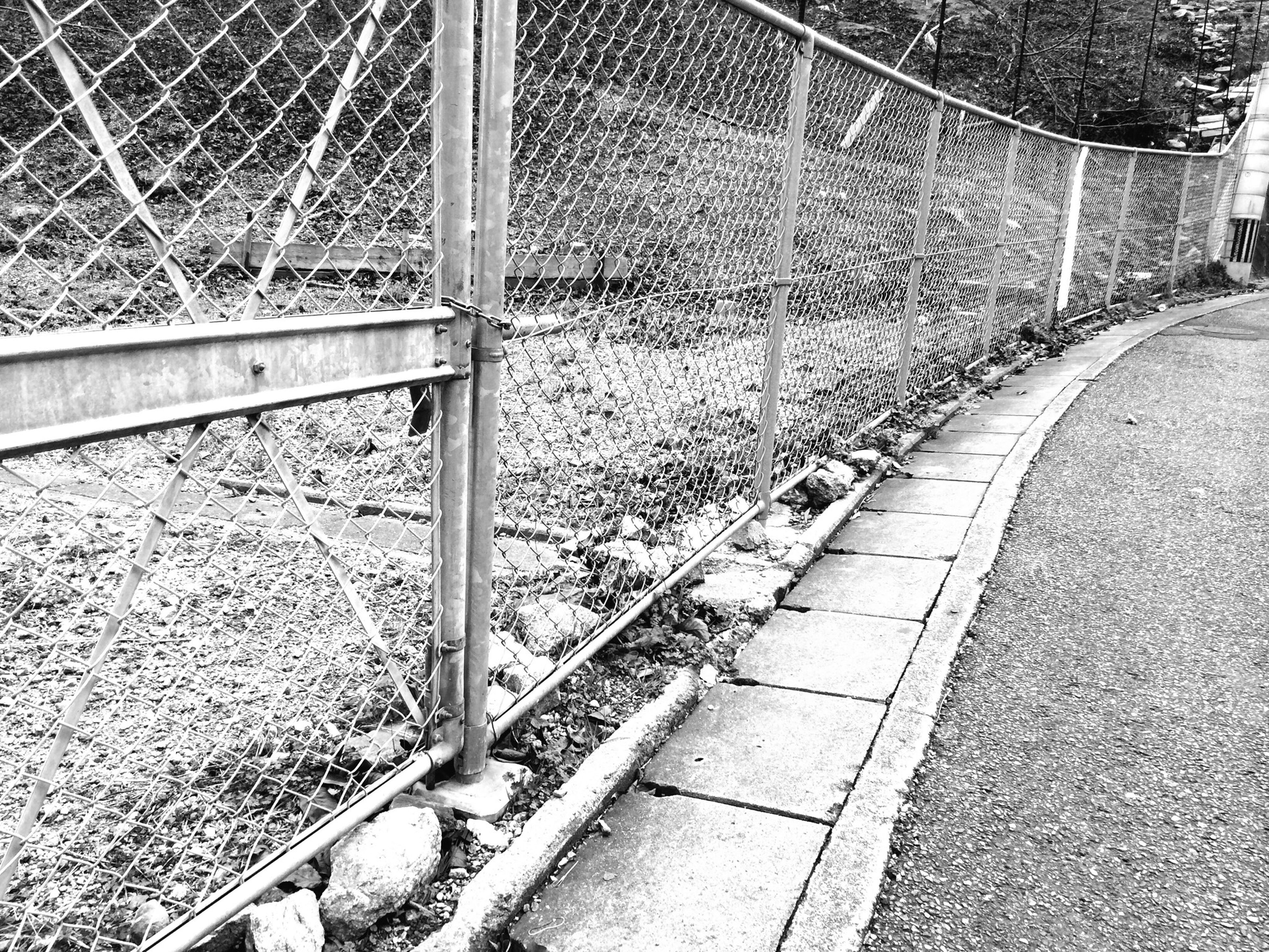 transportation, railroad track, metal, fence, chainlink fence, protection, the way forward, rail transportation, safety, railing, diminishing perspective, day, security, no people, outdoors, sunlight, empty, metallic, road, vanishing point