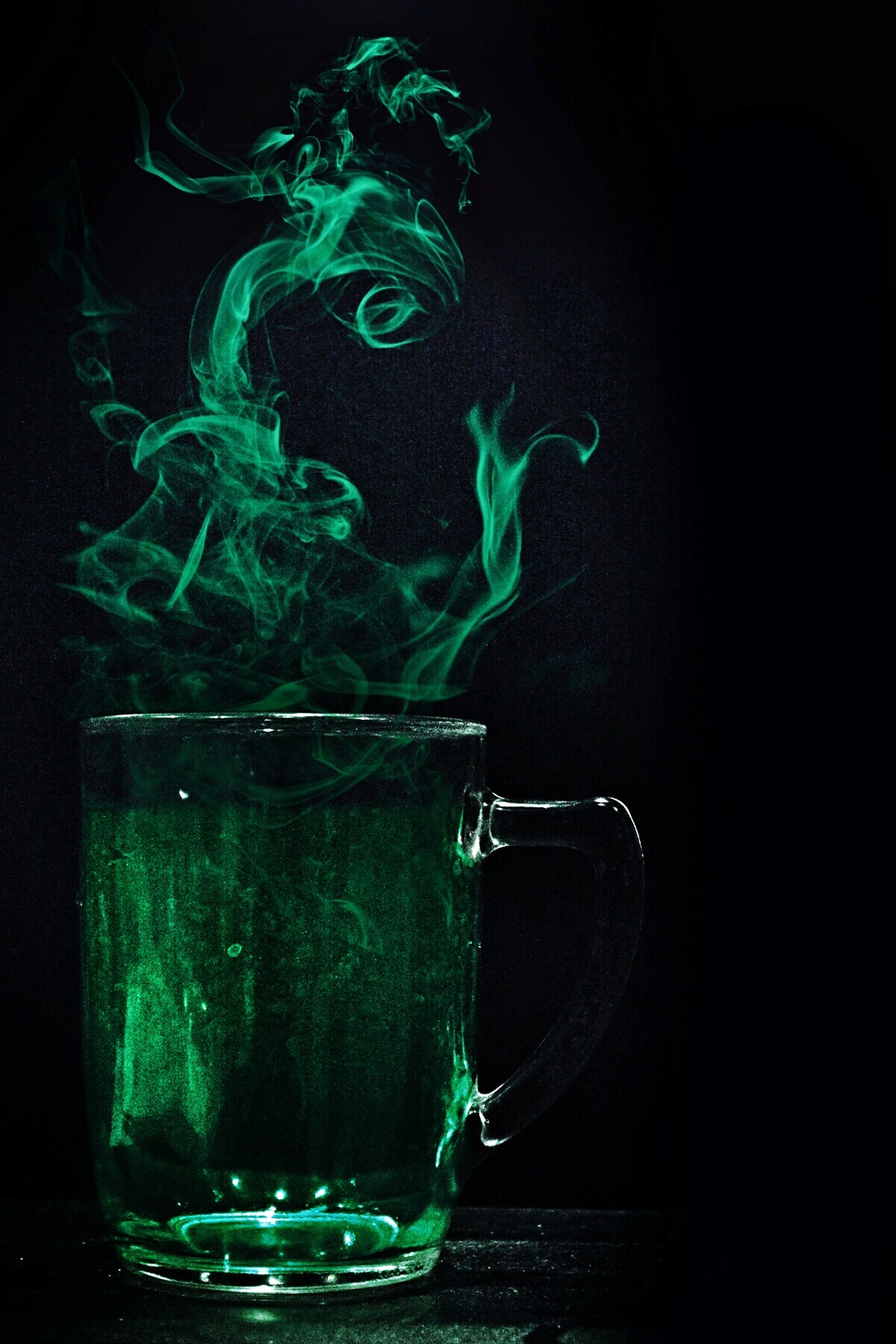 black background, studio shot, drink, water, refreshment, no people, healthy eating, drinking glass, green color, freshness, smoke - physical structure, close-up, indoors