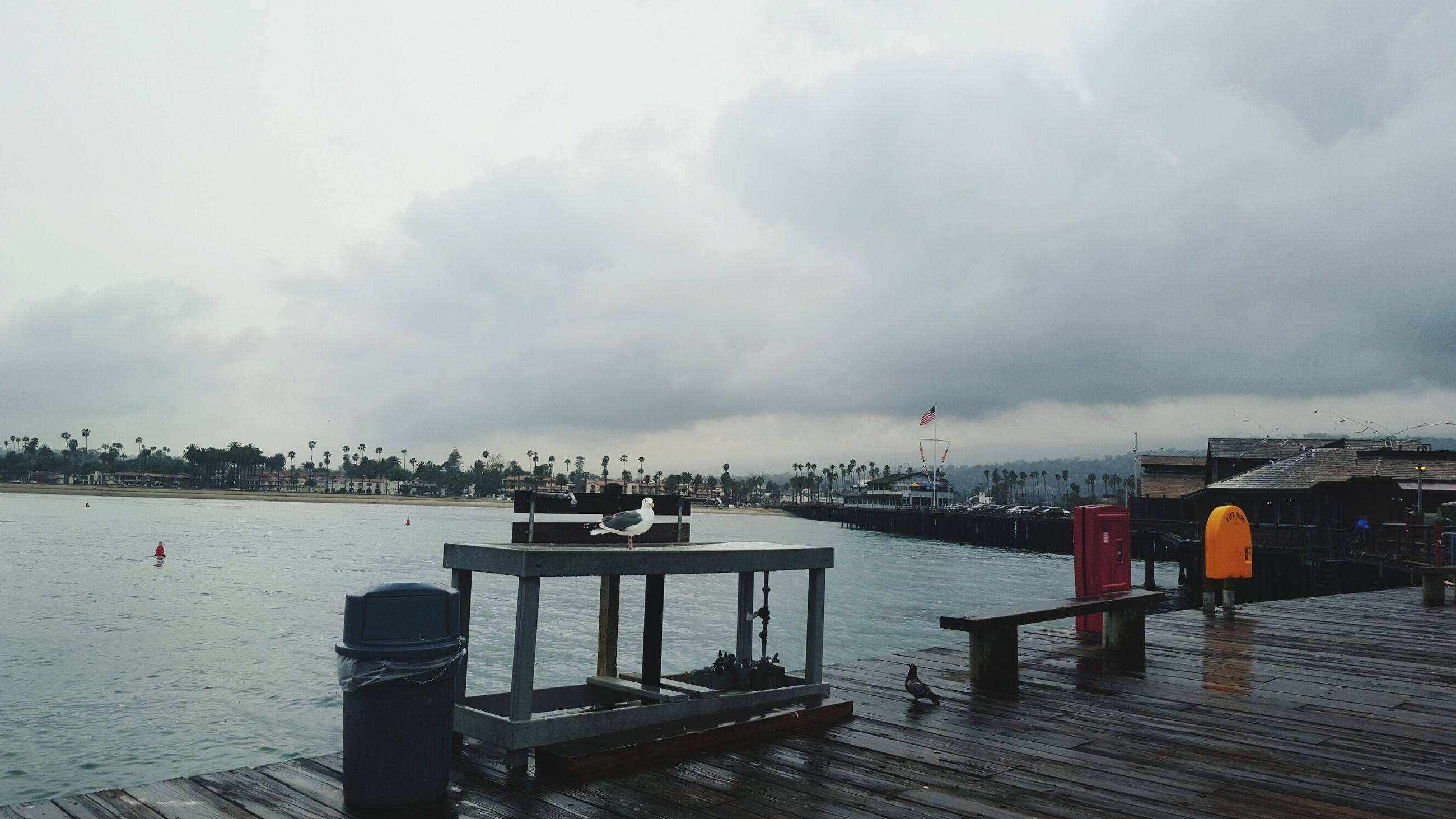 water, sky, cloud - sky, built structure, sea, cloudy, architecture, building exterior, weather, railing, pier, nautical vessel, overcast, outdoors, transportation, river, cloud, city, harbor, day