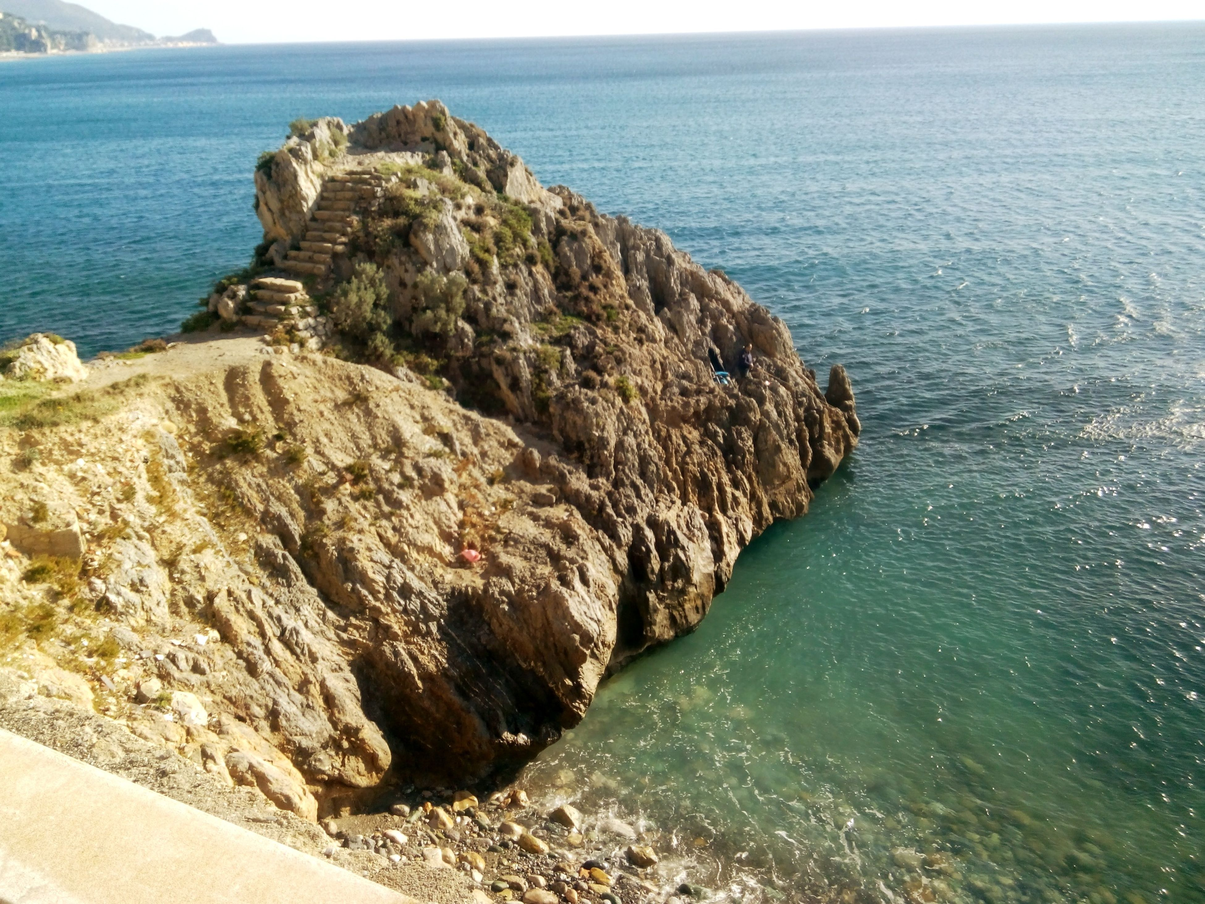 sea, water, horizon over water, rock formation, scenics, rock - object, tranquil scene, tranquility, beauty in nature, rock, nature, cliff, blue, coastline, idyllic, high angle view, sky, shore, seascape, beach