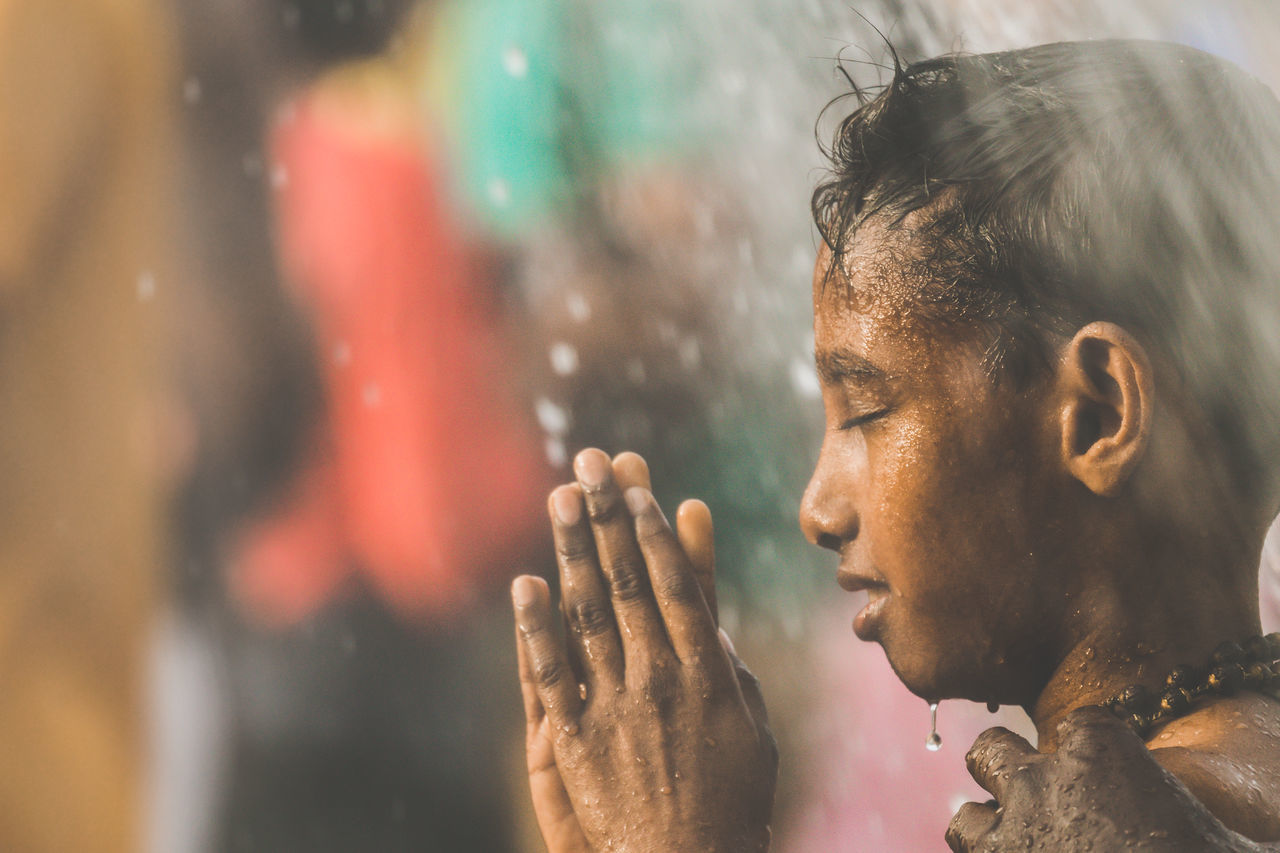 A Hindu devotee takes a shower during Thaipusam festival in Batu Caves, Malaysia to fulfil their vows and offer thanks to the deities. Batu Caves -Malaysia Close-up Day Headshot Hindu Temple Indoors  Men One Man Only One Person Only Men People Praying Thaipusam Young Adult