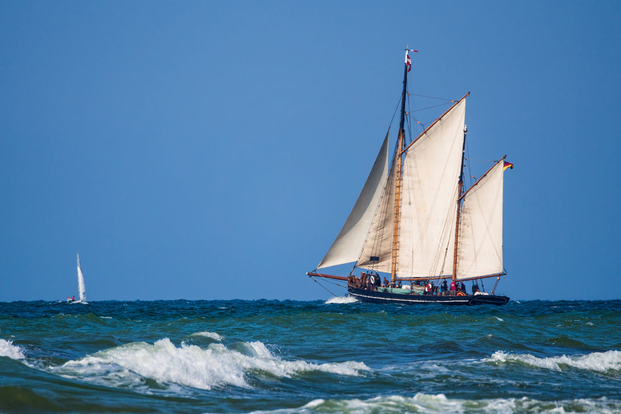 Sailing ship on shore of the Baltic Sea. Baltic Sea Blue Clear Sky Day Journey Nature Nautical Vessel No People Ocean Outdoors Regatta Sailboat Sailing Sailing Ship Sea Sky Sport Tourism Transportation Travel Vacation Water Waves Windjammer Yachting