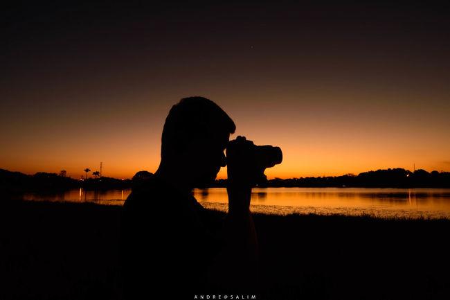 Camera - Photographic Equipment Lagoon One Person Photographer Photographing Photography Themes Silhouette Sunset Water