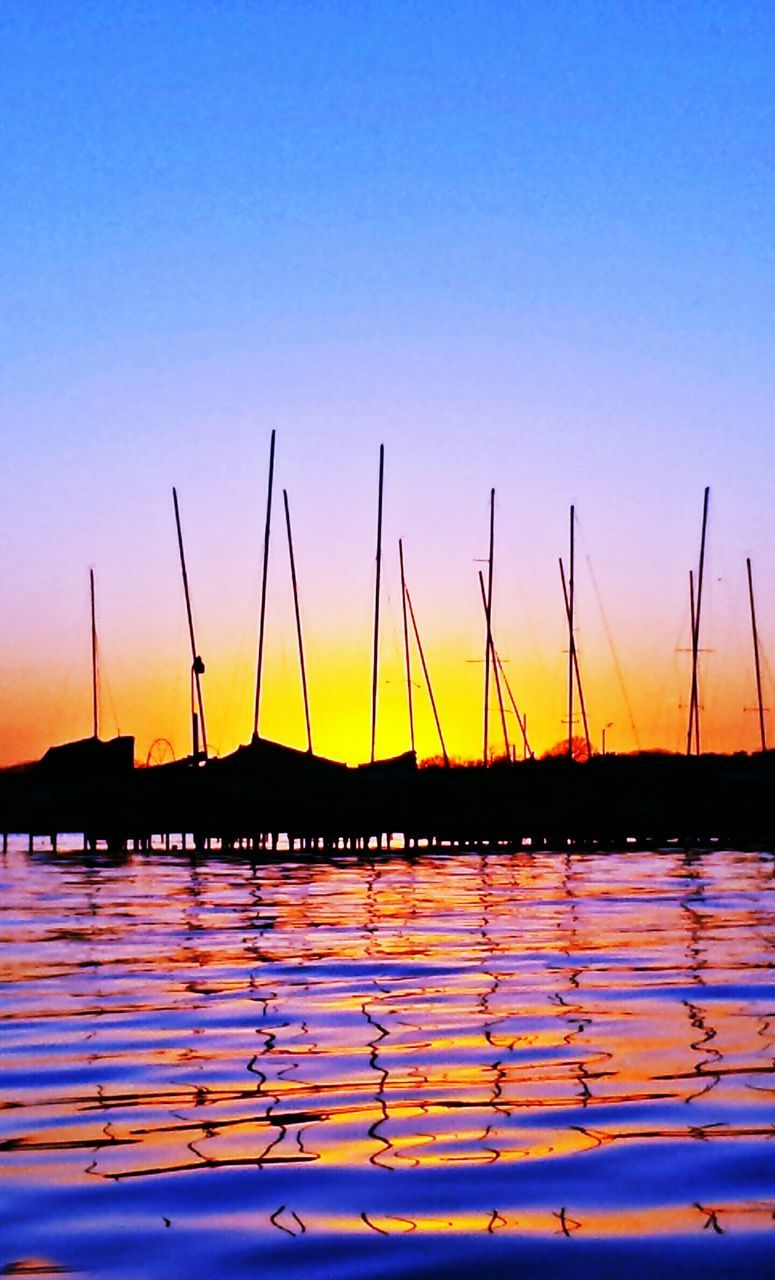 sunset, water, nature, tranquility, beauty in nature, scenics, reflection, sky, nautical vessel, tranquil scene, no people, outdoors, silhouette, sea, sailboat, clear sky, mast, day