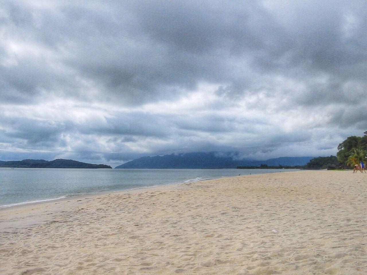 Sand Beach On Cloudy Day