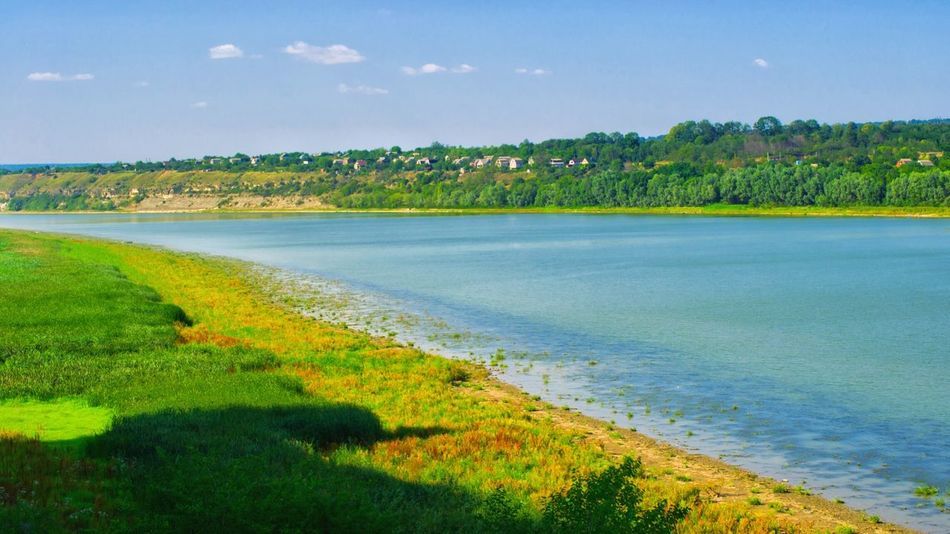Dnister riverside at the Khotyn fortress Landscape Beauty In Nature Nature Outdoors No People Scenics Fort Grass Rural Scene Khotyn Water Ukraine River Riverside River View Dnister Backgrounds Patterns In Nature Summer Summertime Riverscape Panoramic Landscape Outdoor Photography Outdoor beauty in Nature
