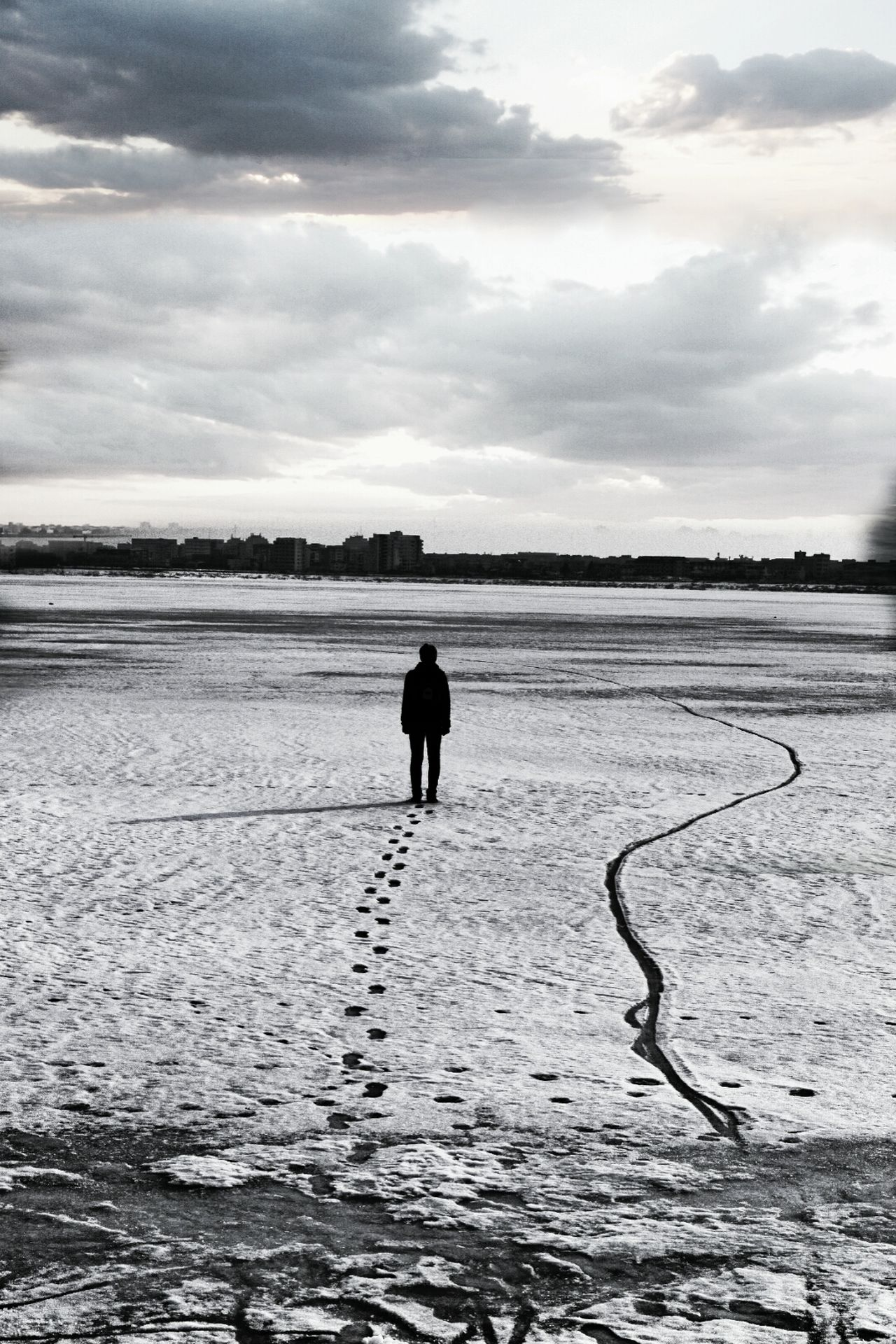 In the middle of a frozen lake near the town of Bucharest Full Length Silhouette Rear View Landscape Lake Cloud - Sky One Person Scenics Adults Only Outdoors Water One Man Only Day People Only Men Nature Sky Wheat Freshness First Eyeem Photo Rural Scene Tranquil Scene Cereal Plant Backgrounds Beautiful Woman
