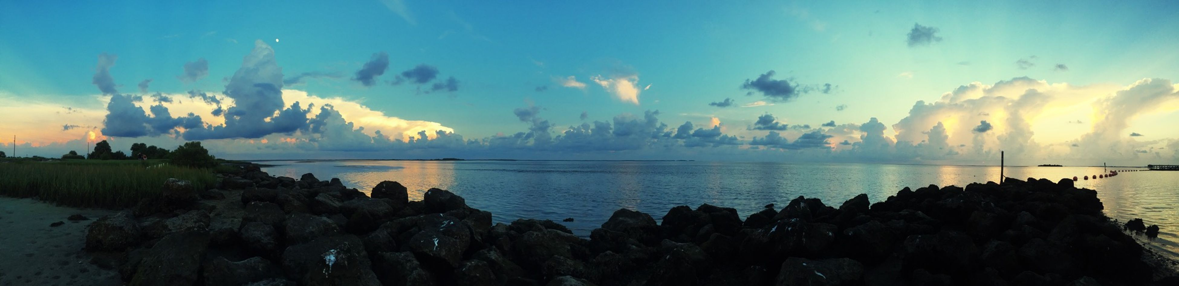 water, sea, tranquil scene, scenics, sky, tranquility, beauty in nature, horizon over water, nature, idyllic, sunset, cloud - sky, beach, reflection, panoramic, rock - object, shore, cloud, blue, dusk