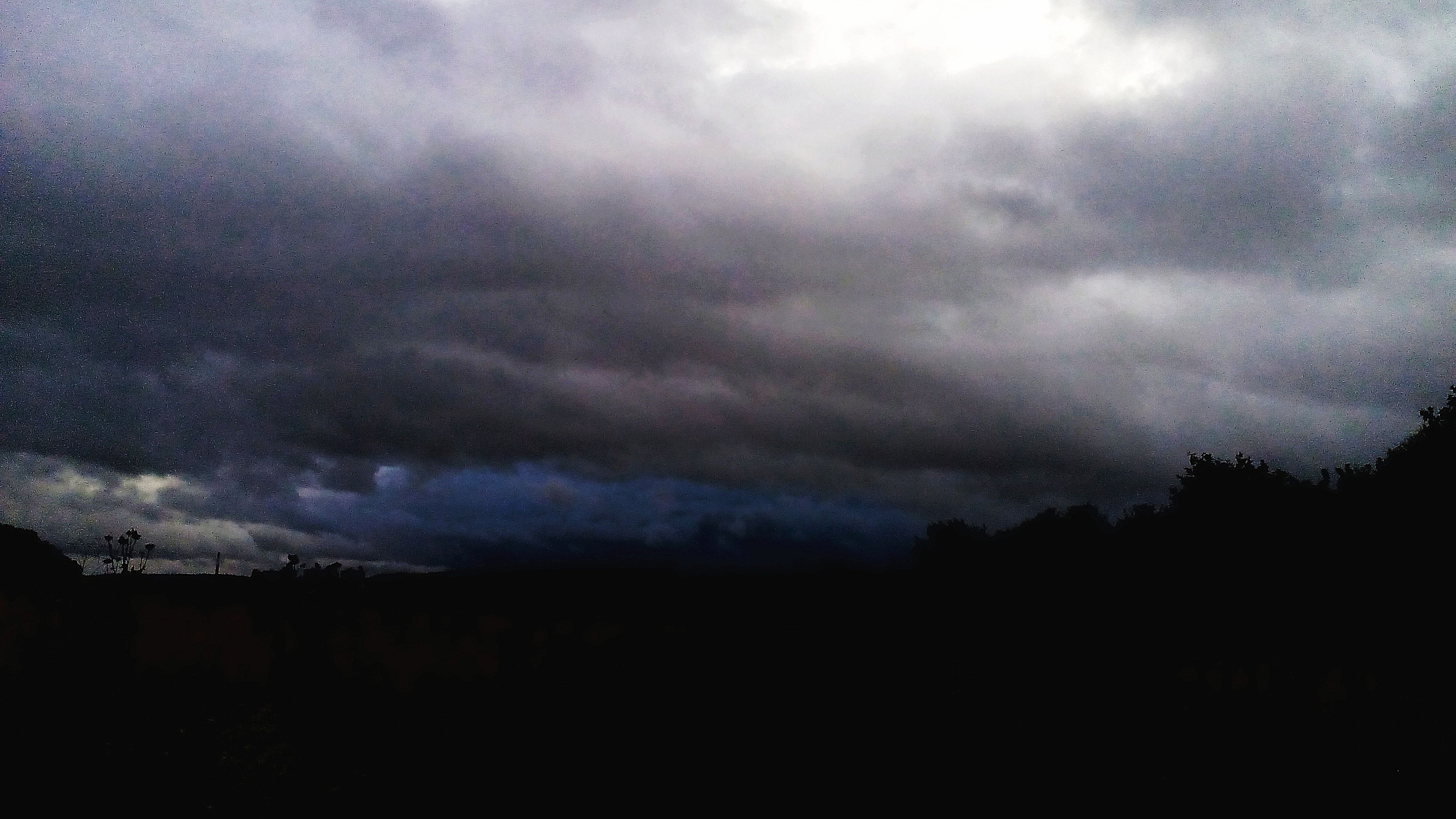 silhouette, sky, tranquil scene, scenics, tranquility, landscape, dark, beauty in nature, nature, cloud - sky, outline, majestic, storm cloud, cloud, cloudy, outdoors, calm, ominous, dramatic sky, non-urban scene, no people, cloudscape