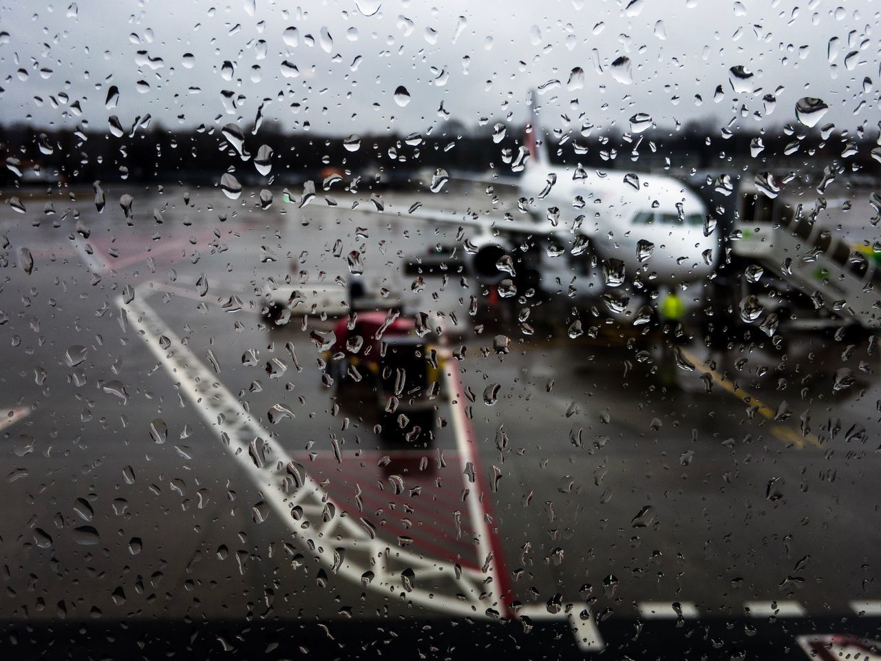 transportation, rain, wet, drop, window, travel, mode of transport, airplane, land vehicle, raindrop, no people, journey, road, day, runway, sky, outdoors, airport runway, air vehicle, water, close-up, nature, airplane wing