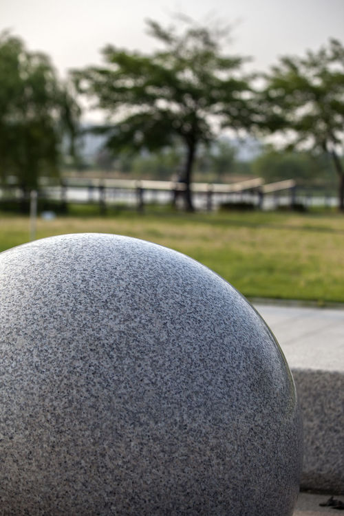 Architecture Ball Beauty In Nature Bucheon Lake Park Close-up Day Focus On Foreground Grass Green Color Growth Landscape Nature No People Outdoors Park Parking Part Of Selective Focus Sky Stone Sunny Tranquil Scene Tranquility Tree