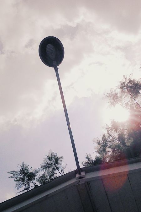 Communication Low Angle View Cloud - Sky Sky No People Outdoors Day Modern Light And Shadow Minimalism Shiny Sunbeam Sunny Day Streetphoto Streetlights And Sky Streetlightcollection The City Light