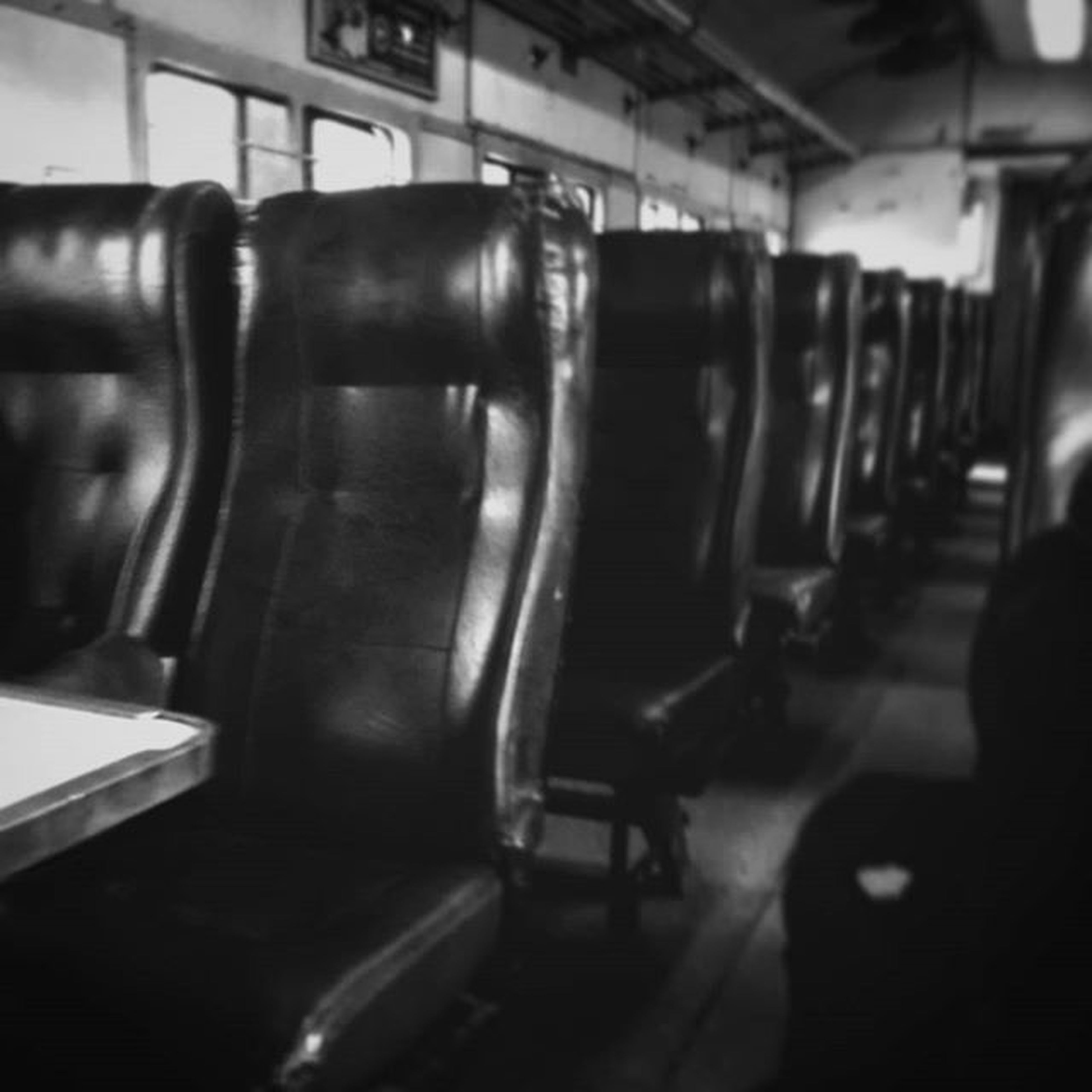 indoors, illuminated, men, incidental people, selective focus, interior, public transportation, empty, absence, window, architecture, transportation, focus on foreground, vehicle seat, in a row, built structure, flooring