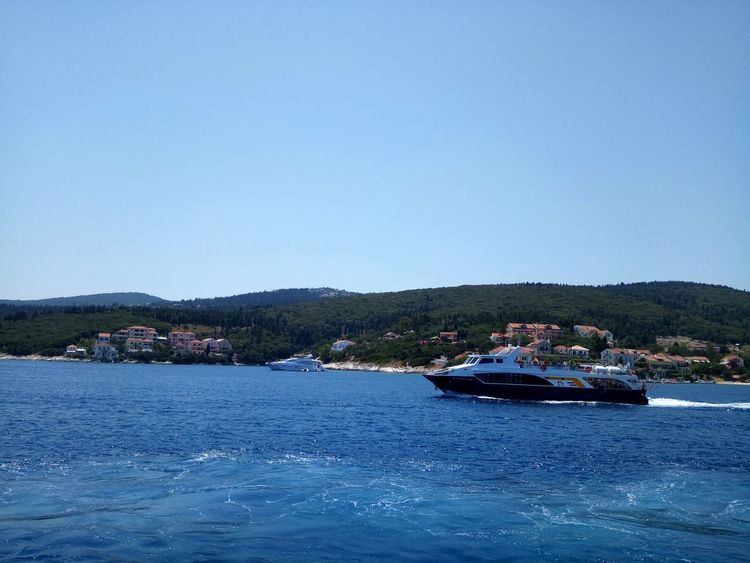 Nautical Vessel Harbor Sea No People Beach Outdoors Moored Water Clear Sky Blue Day Archipelago Nature Sky Been There. Ionianislands Ionian Sea