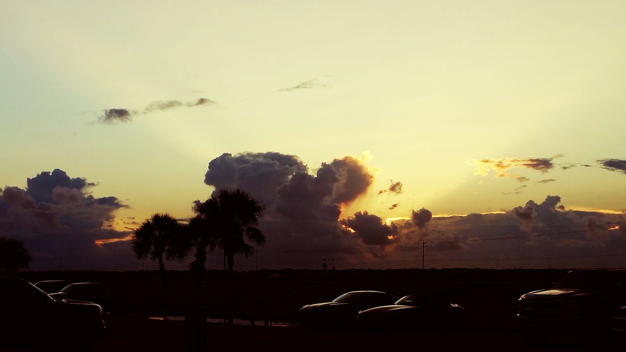 car, land vehicle, transportation, sunset, mode of transport, sky, cloud - sky, silhouette, nature, no people, beauty in nature, tree, outdoors, scenics, day