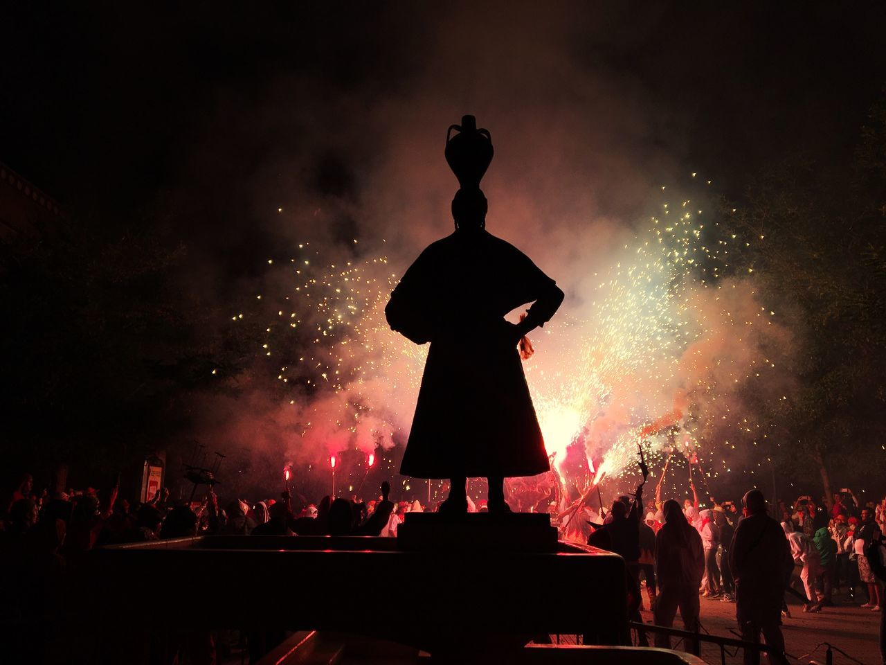 night arts culture and entertainment real people illuminated men large group of people performance crowd outdoors sky Fireworks correfocs Fraga