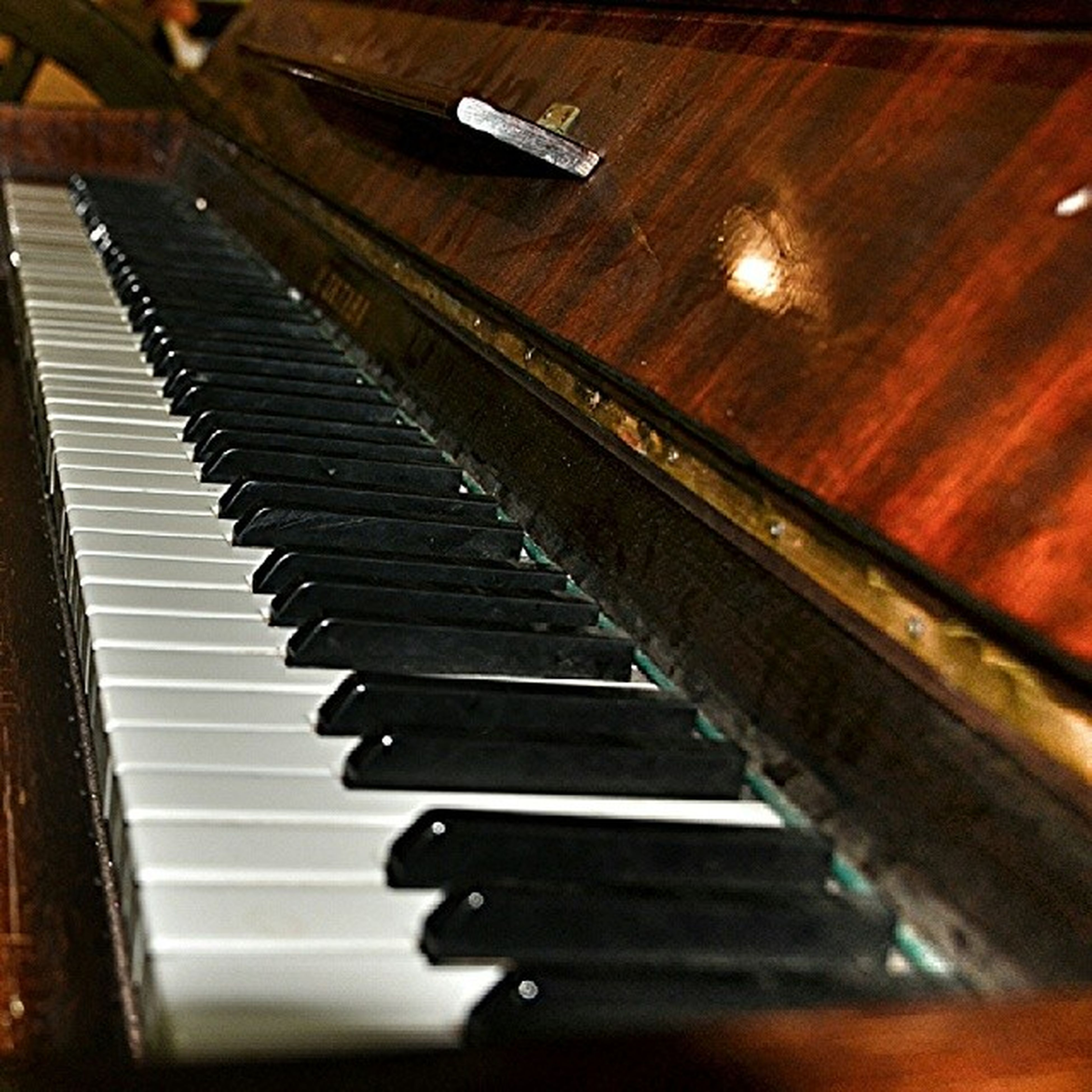 indoors, music, musical instrument, arts culture and entertainment, piano key, musical equipment, piano, close-up, high angle view, technology, guitar, selective focus, musical instrument string, table, still life, steps, wood - material, in a row, steps and staircases, no people