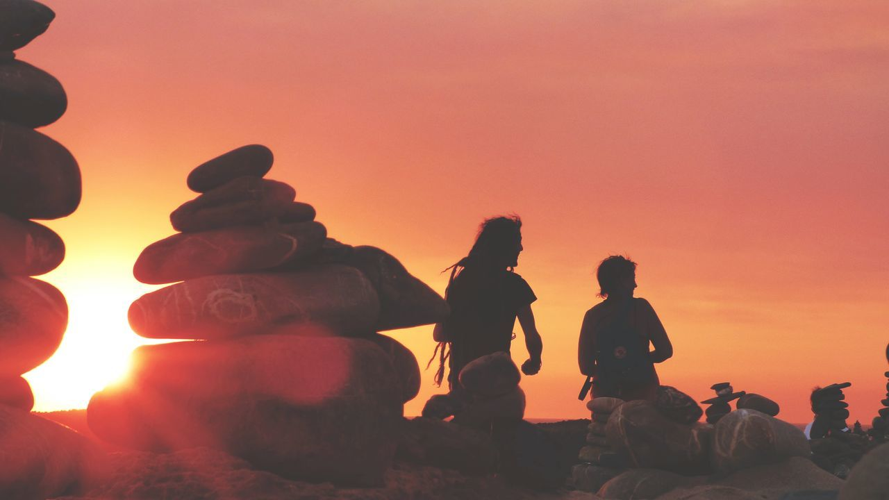 Orange Color Sunset Silhouette Adult People Togetherness Two People Outdoors Sky Day Nature Adults Only Zen Rock At Sunset Zen Rock At Beach Zen Rocks Sitting Sunset Silhouettes Sunset_captures Sunsets Paint The Town Yellow