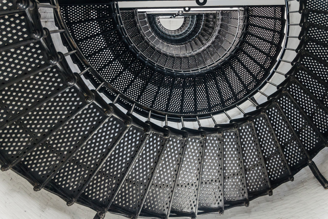 Low Angle View Of Metallic Spiral Staircase
