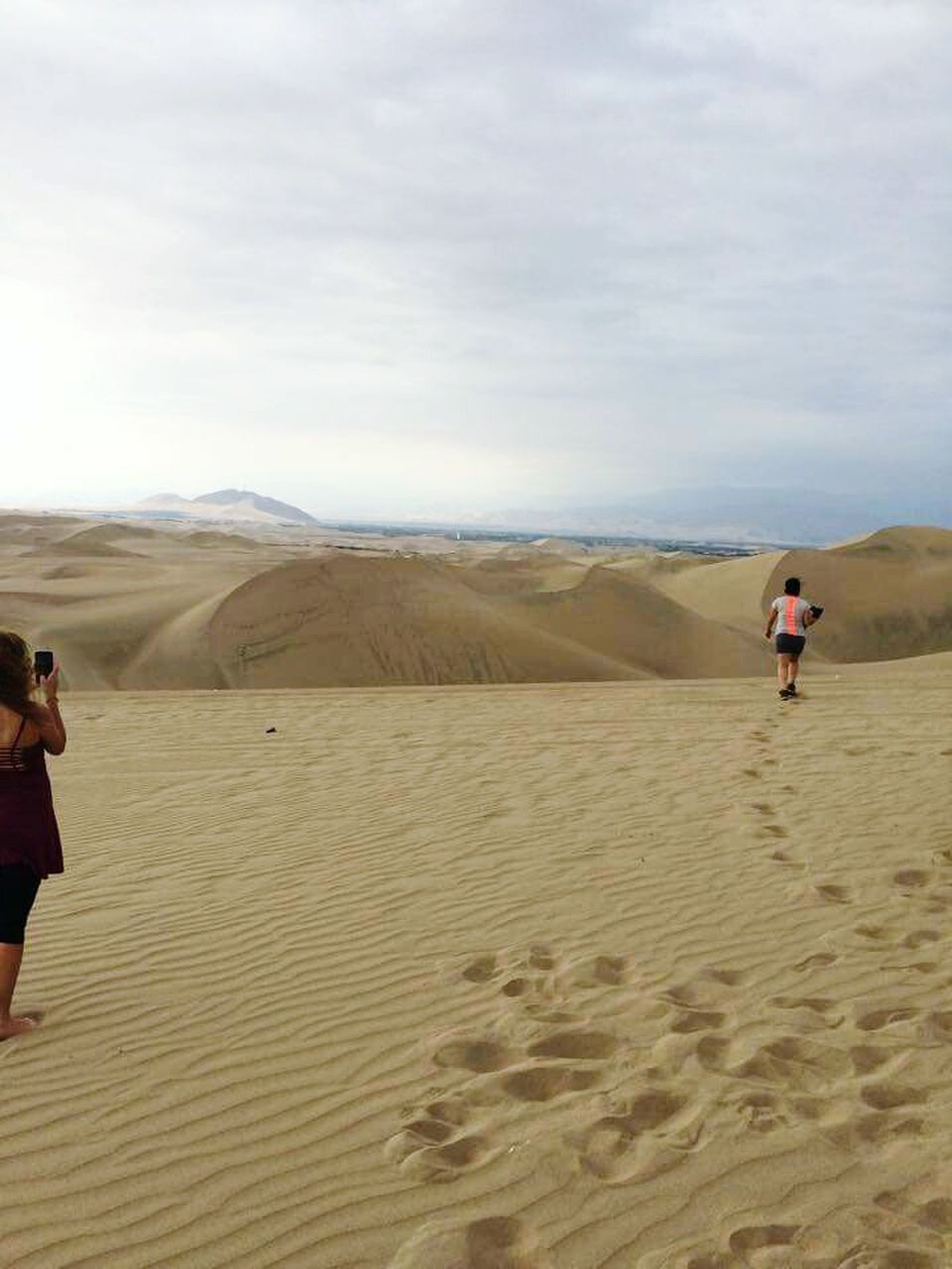 sand, desert, two people, nature, sky, sand dune, landscape, outdoors, day, beach, arid climate, scenics, women, adult, people, men, real people, standing, adults only, young adult, mountain, friendship, only men
