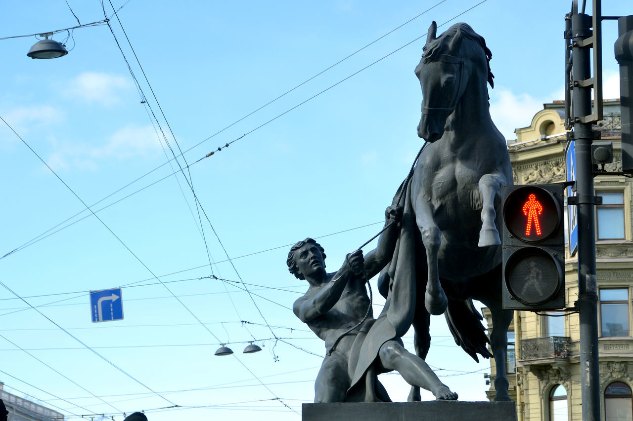 Sculpture on Anichkov Bridge (The Horse Tamers, designed by the Russian sculptor, Baron Peter Klodt von Jurgensburg) Saint Petersburg, Russia Anichkov Bridge Sculptures Blue City Cloud Colour Of Life Day Horse Riding Low Angle View No People Russia Saint Petersburg Sculpture Sky Battle Of The Cities