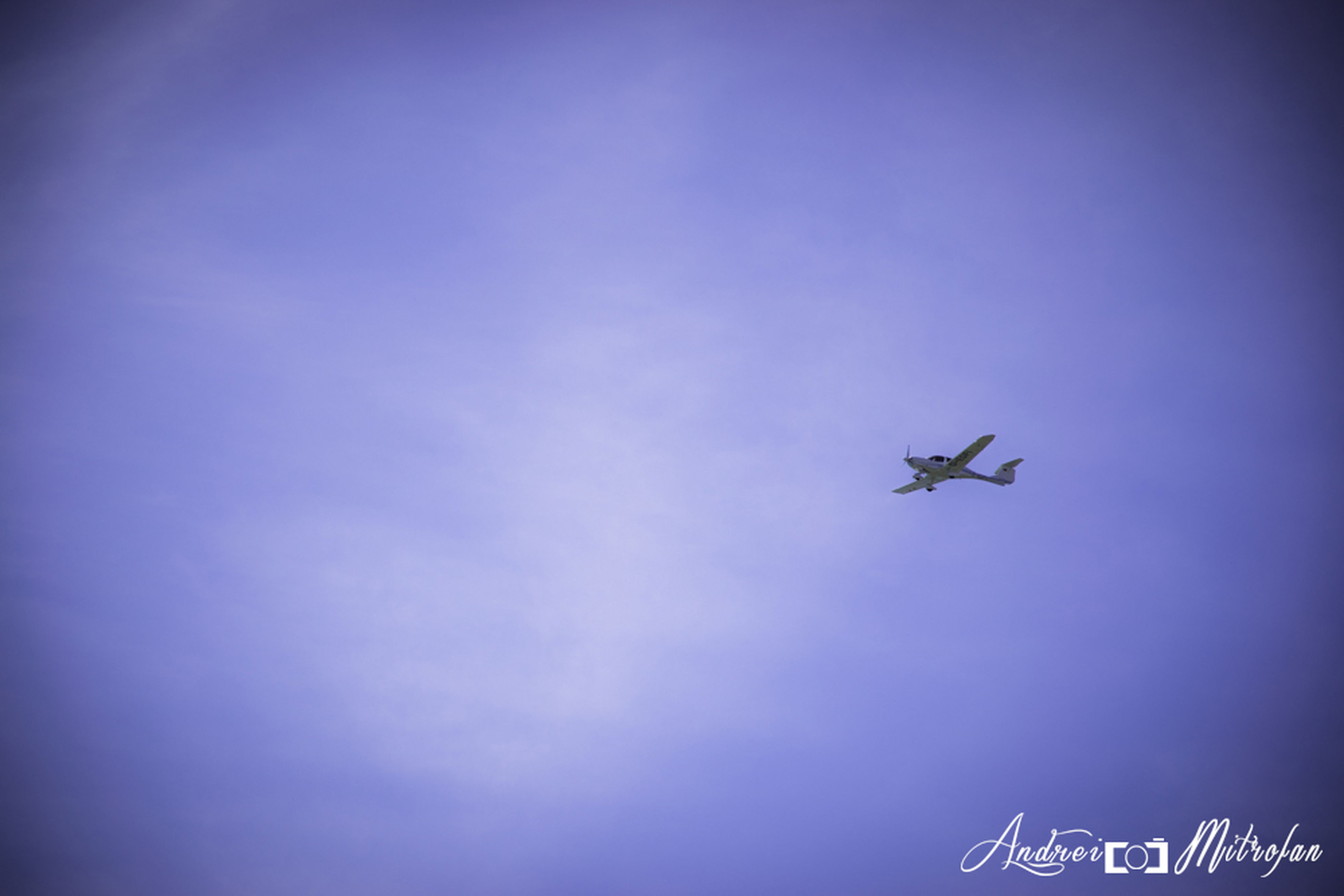 transportation, air vehicle, mode of transport, airplane, flying, low angle view, mid-air, blue, on the move, sky, travel, journey, copy space, outdoors, silhouette, day, no people, speed, nature, public transportation