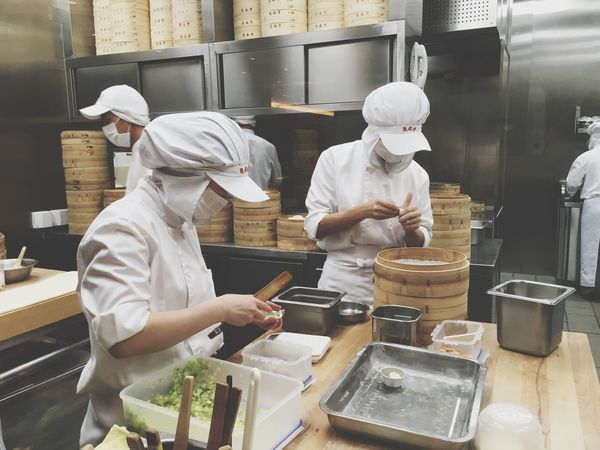 Commercial Kitchen Occupation Working Food And Drink Establishment Indoors  Real People Uniform Men Two People Restaurant Food And Drink Industry Food And Drink Preparation  Chef Skill  Food Chef's Hat Factory Teamwork Bakery