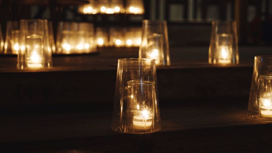 Illuminated Focus On Foreground Indoors  Drinking Glass No People Close-up Food And Drink Restaurant Drink Alcohol Half Full Table Night Drinking Water Freshness Tea Light Festival Of Lights Candlelight Christmas Lights Low Angle View Light Effect Lighting Equipment Electricity  Light Bulb Livestock