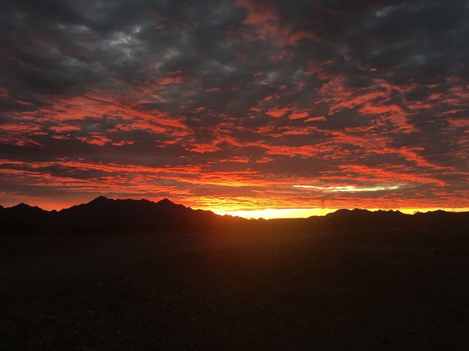 Sunrise over the Dome Rock Mountains in the Arizona desert. Beauty In Nature Nature Scenics Tranquility Cloud - Sky Tranquil Scene Idyllic Landscape Dramatic Sky No People Outdoors Mountain Sky Arizona Desert Arizona Arizona Sky Sunrise Arizona Sunrise